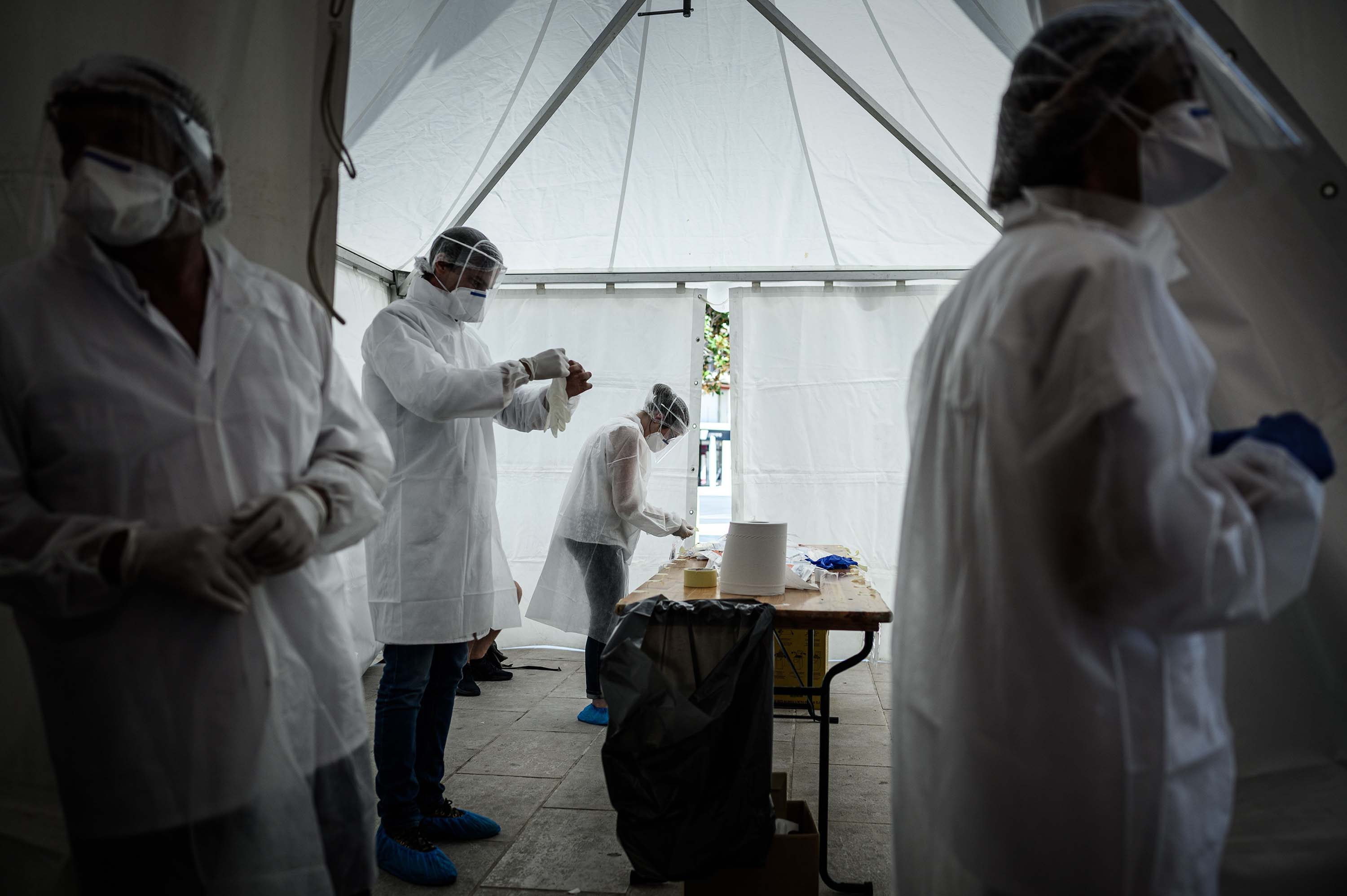 Medical staff work during a coronavirus free screening operation outside the Arcachon railway station in southwestern France, on July 24.