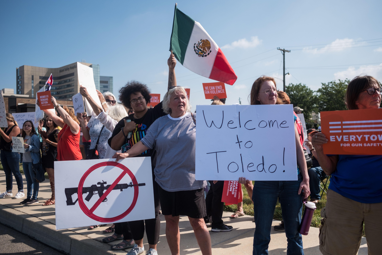 Demonstrators protest the visit of President Trump to Dayton