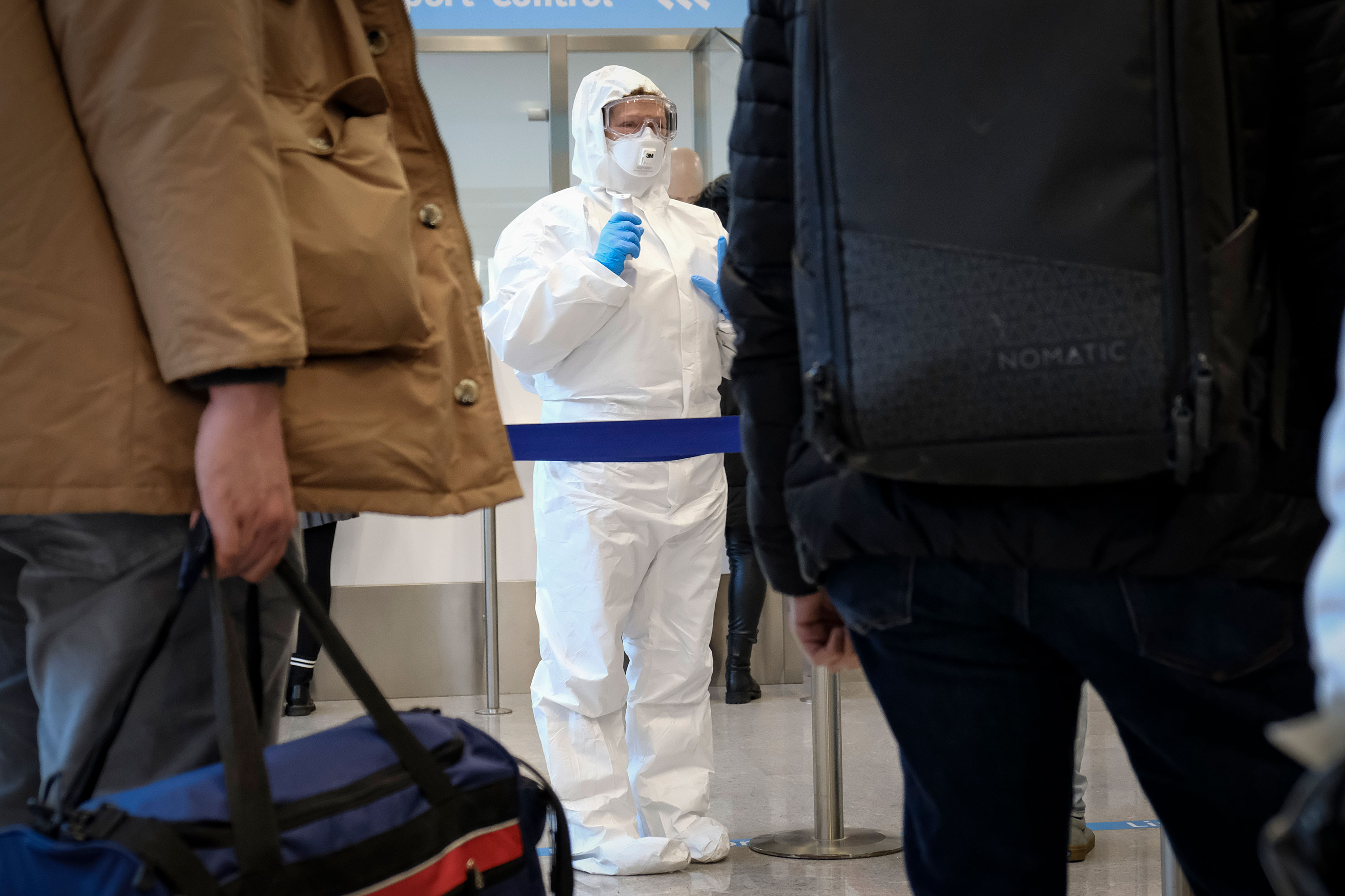 Health officials  measure the body temperature of incoming passengers. Trieste, 28th of February 2020. (Photo by Jacopo Landi/NurPhoto via Getty Images)