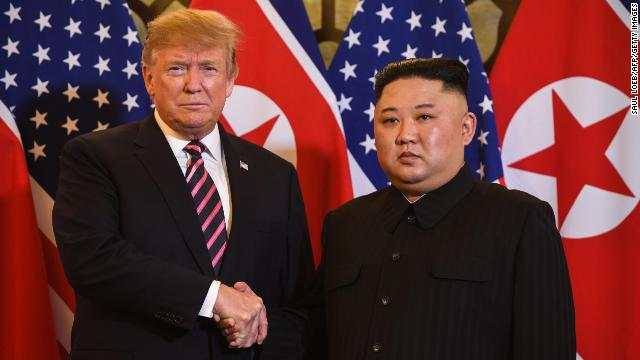 Trump shakes hands with Kim before a meeting at the Sofitel Legend Metropole hotel in Hanoi on February 27.
