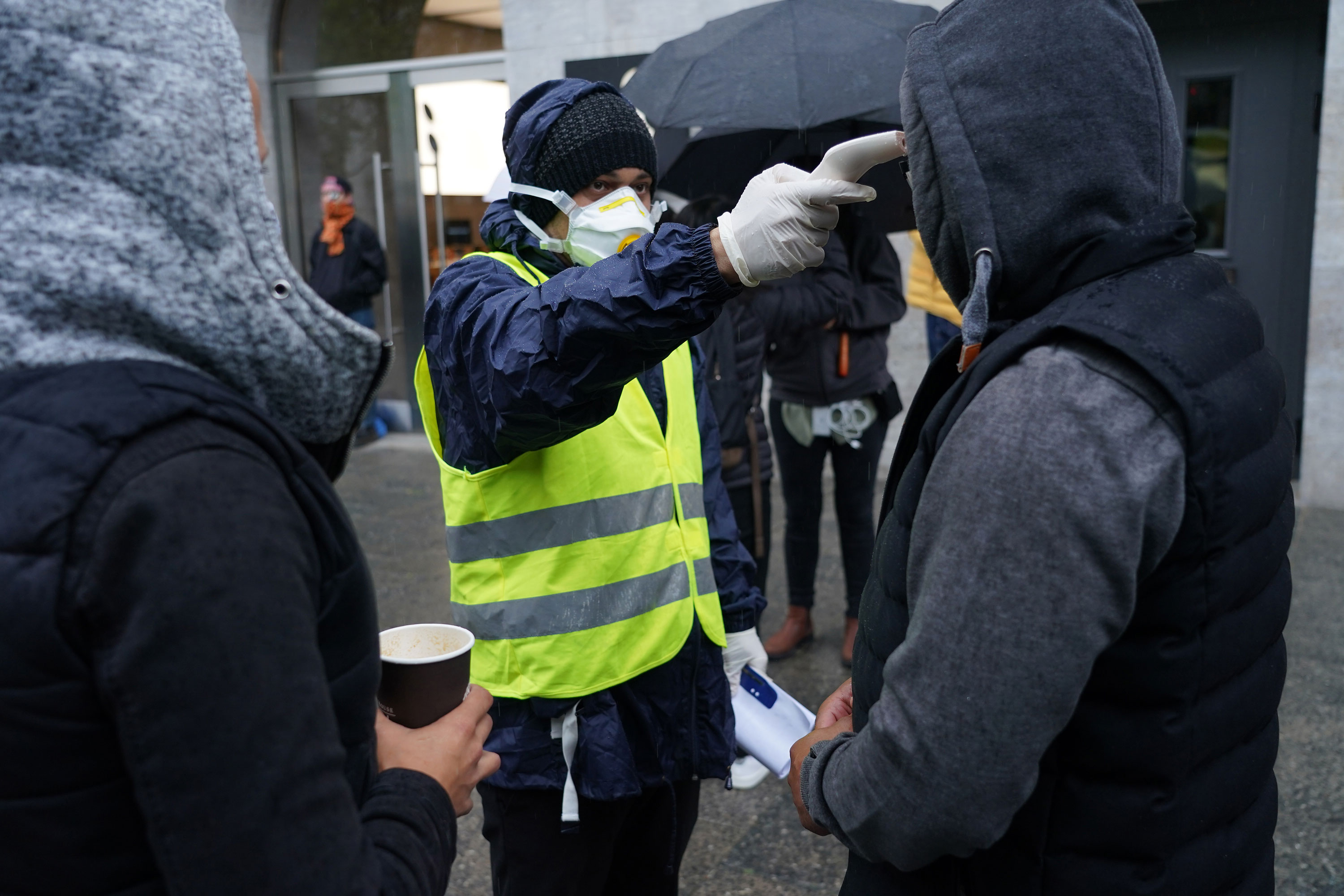 A security guard checks the body temperature of a customer on May 11 in Berlin.