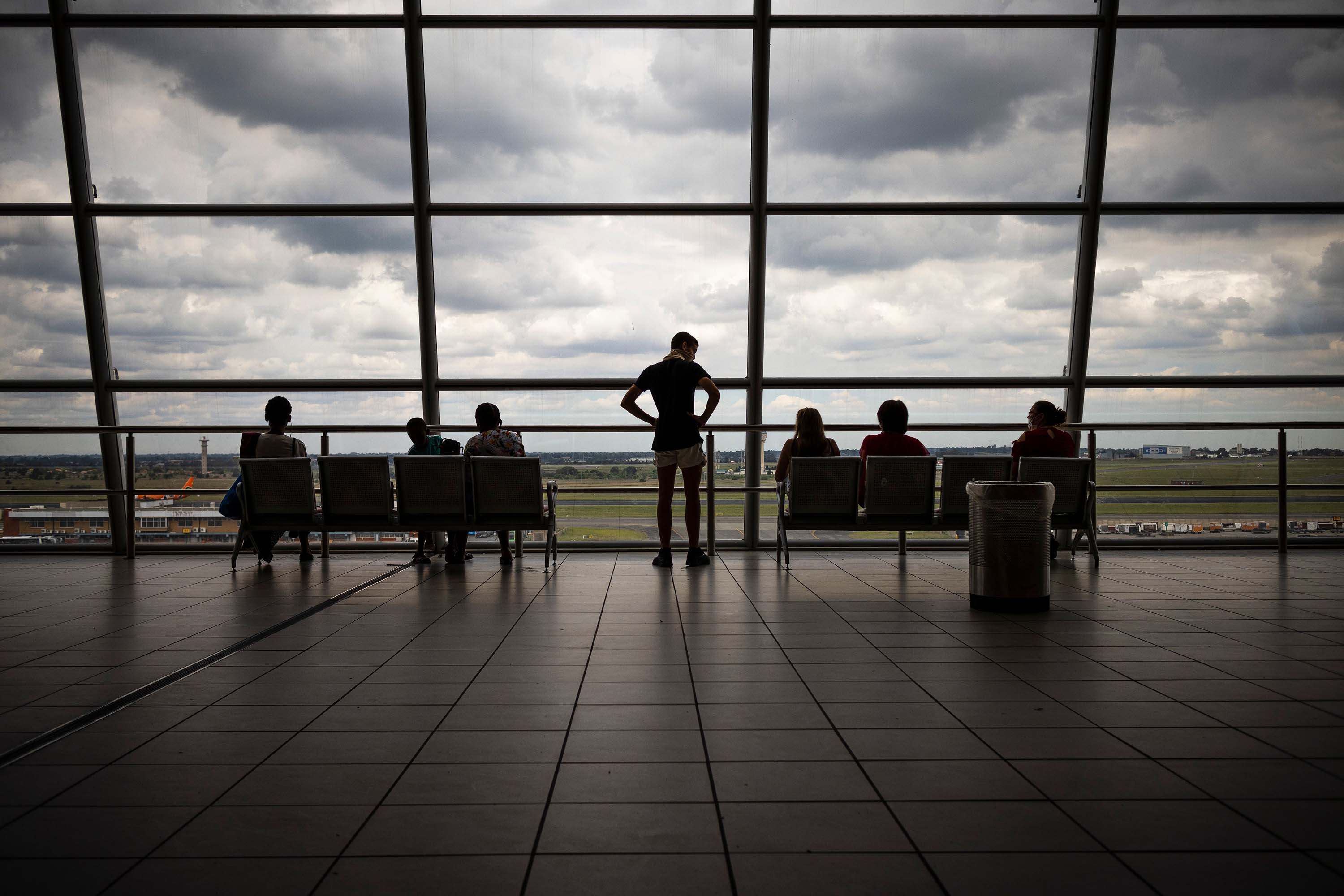 Passengers view planes from the observation deck at the OR Thambo International airport in Johannesburg, South Africa, on December 21, 2020.