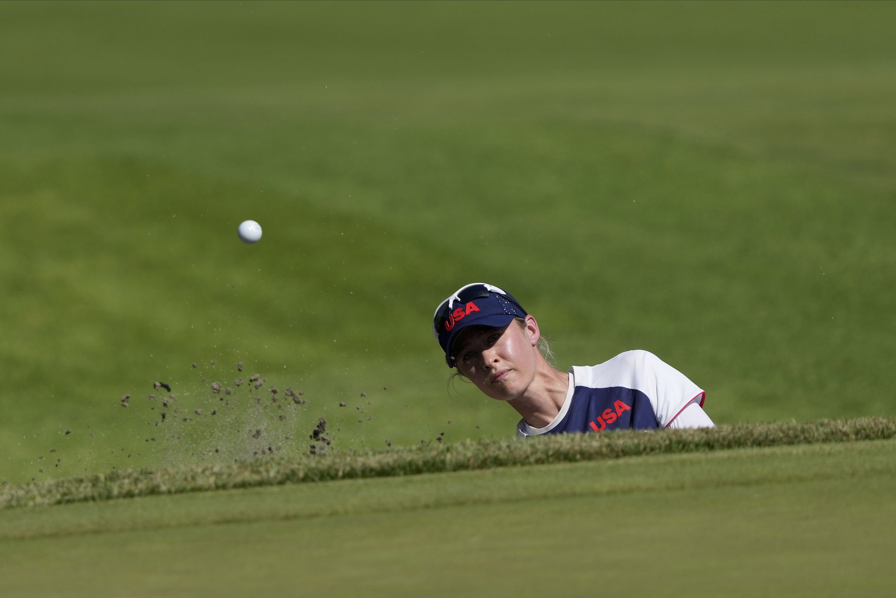 Nelly Korda of the United States plays a shot from a bunker on the 18th hole during the second round of the women's golf event on Thursday.