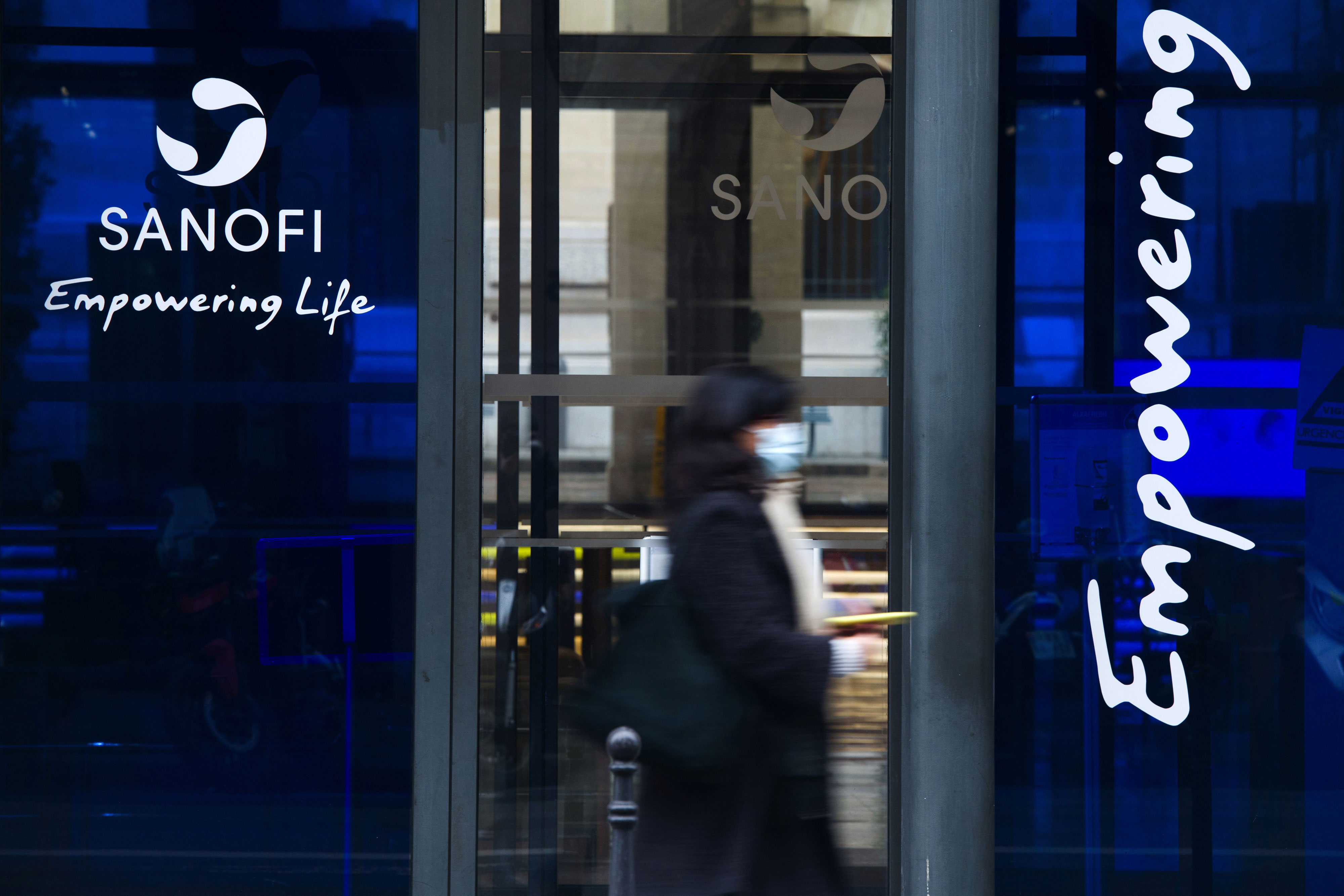 A person passes the Sanofi office in Paris on January 28.