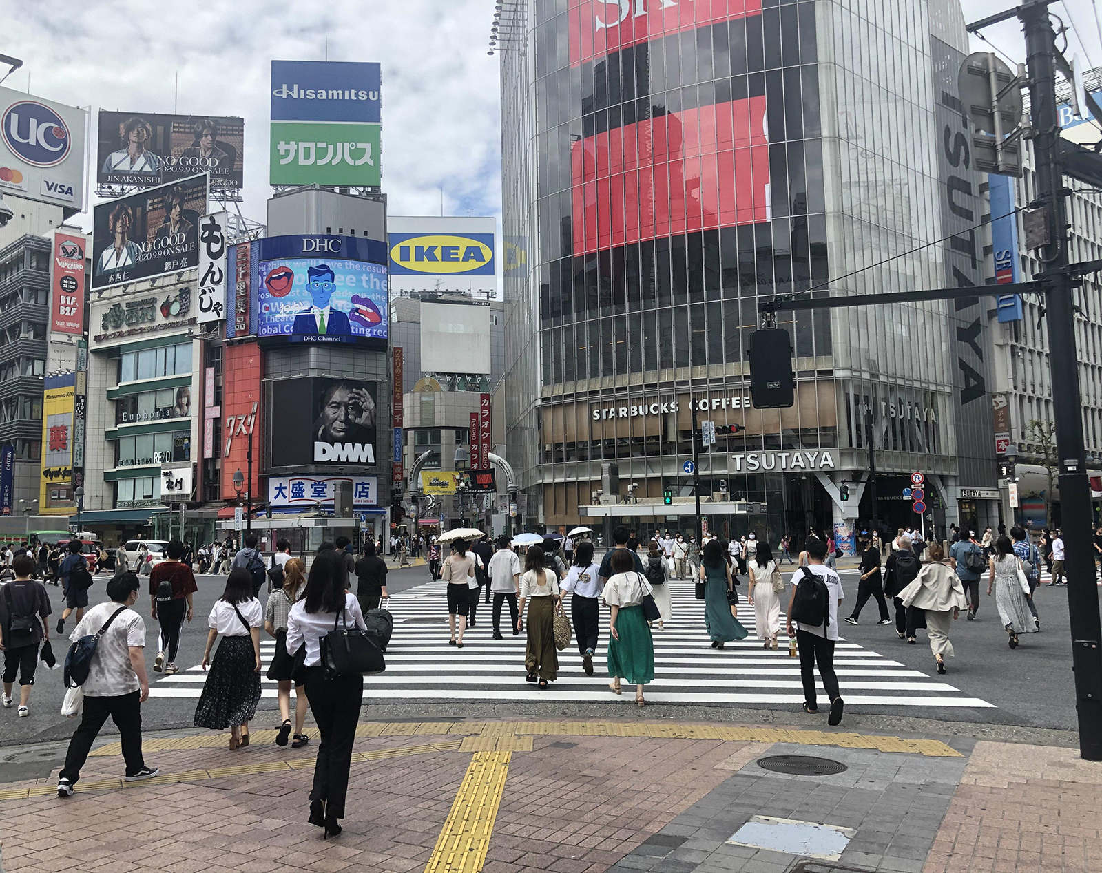 People cross an intersection in front of Shibuya Station amid the coronavirus outbreak in Tokyo, on September 10.