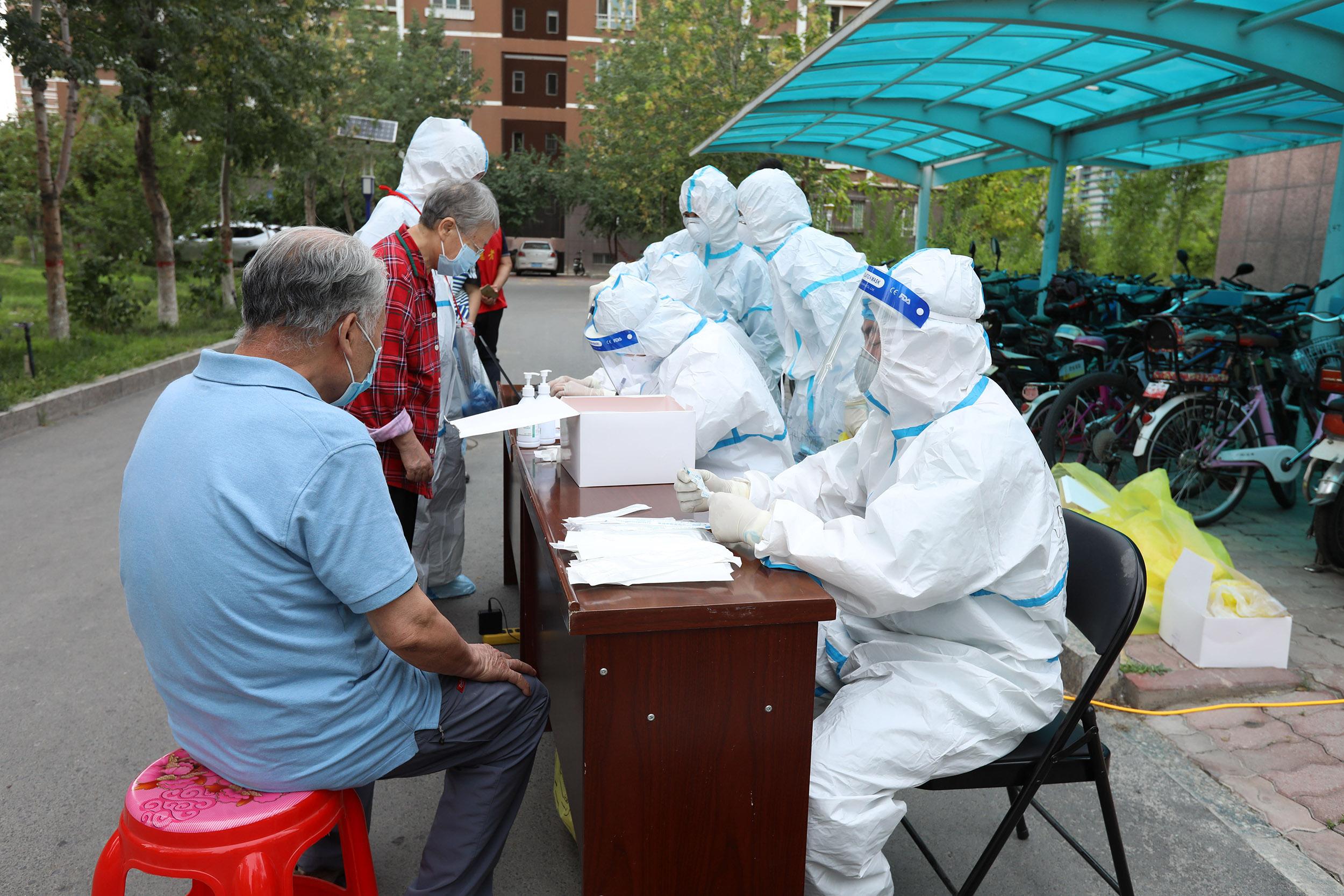 Residents undergo coronavirus testing in the Xinjiang province of China, on August 1.