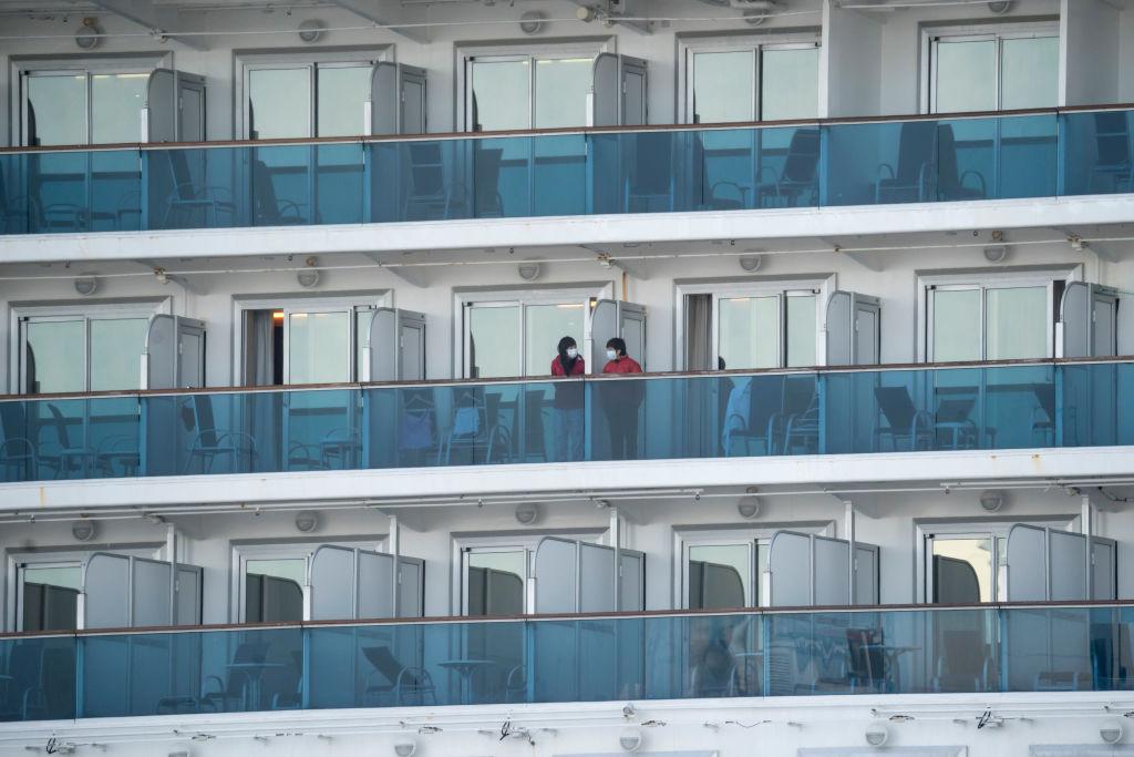 People are seen on the Diamond Princess cruise ship docked at Daikoku Pier on Wednesday, February 19, in Yokohama, Japan.