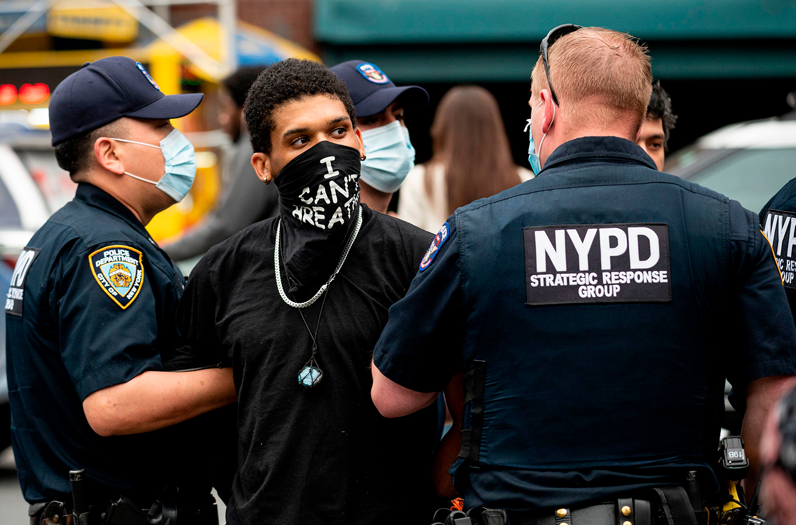 "NYPD officers arrest a protestor during a ""Black Lives Matter"" demonstration on May 28, in New York City."