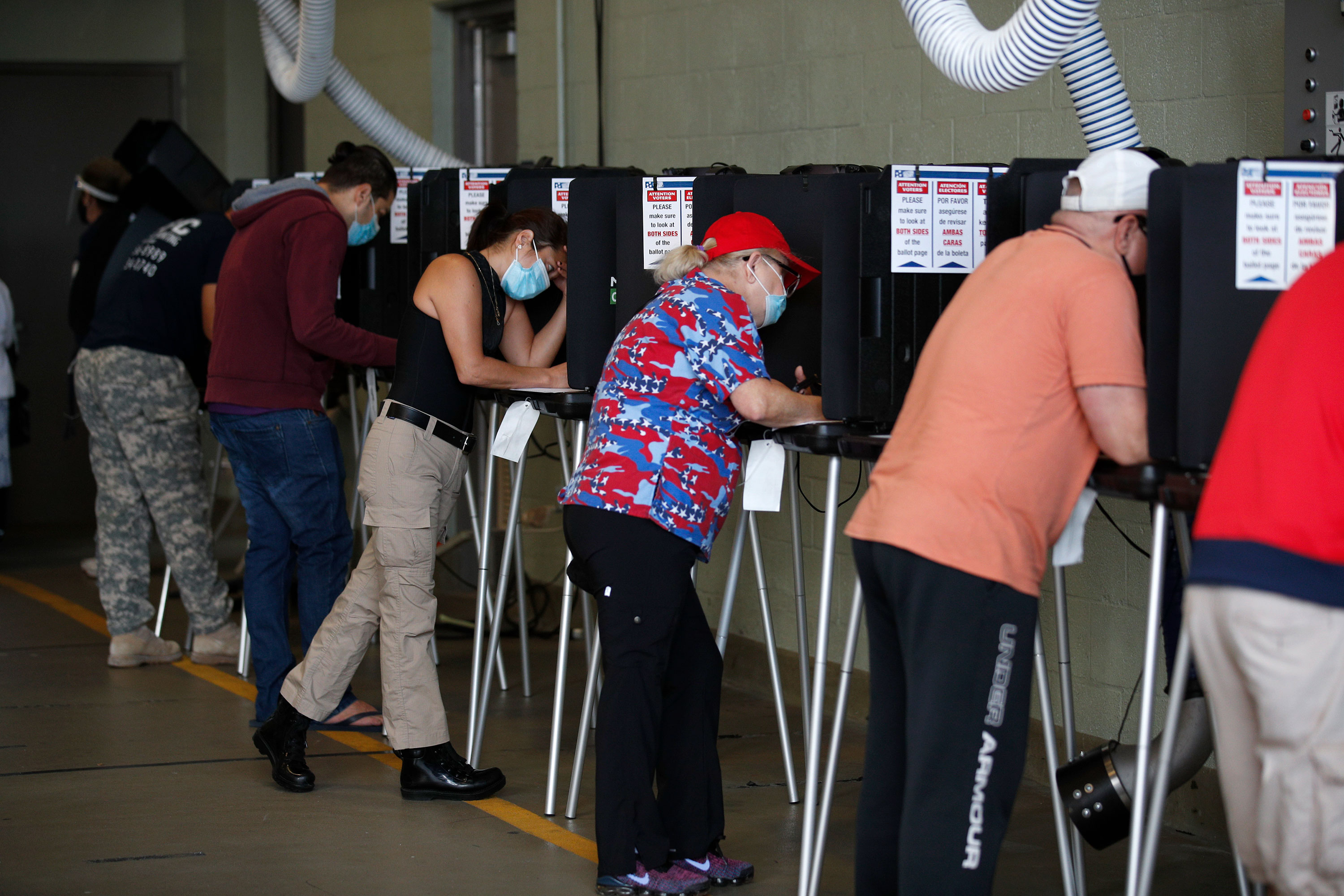 Voters fill out their ballots at a polling place in Miami Beach, Florida, on November 3.