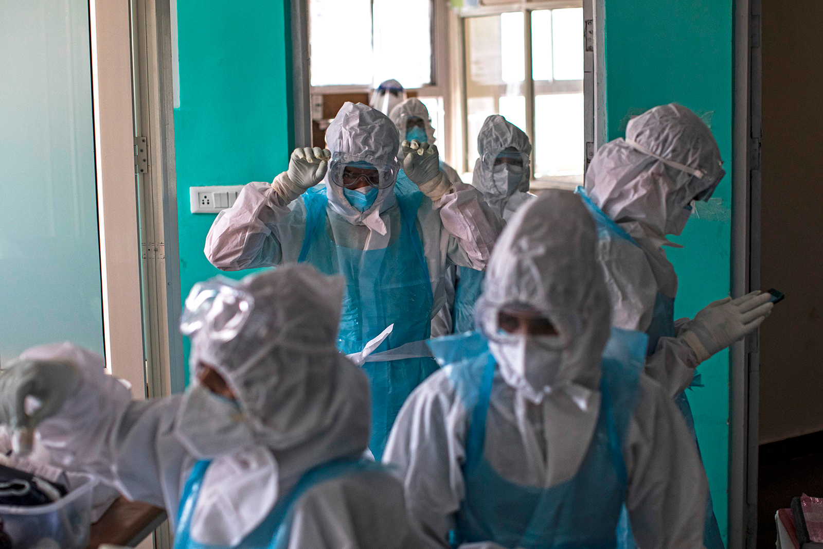 Doctors and nurses wearing personal protective equipment (PPE) suits at a hospital in Greater Noida, India, on July 15.