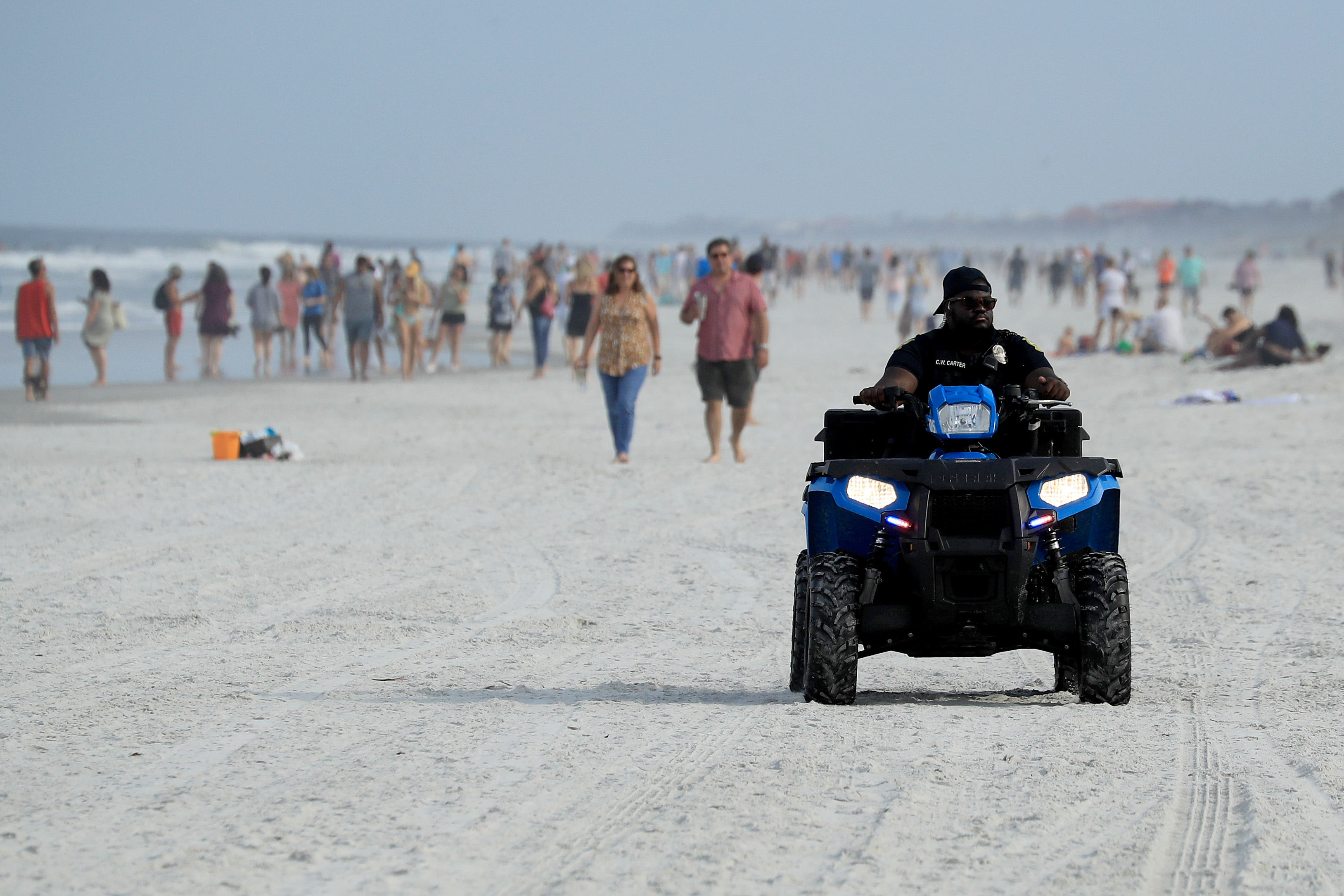 A policeman drives along the beach in Jacksonville Beach, Florida, on April 19.