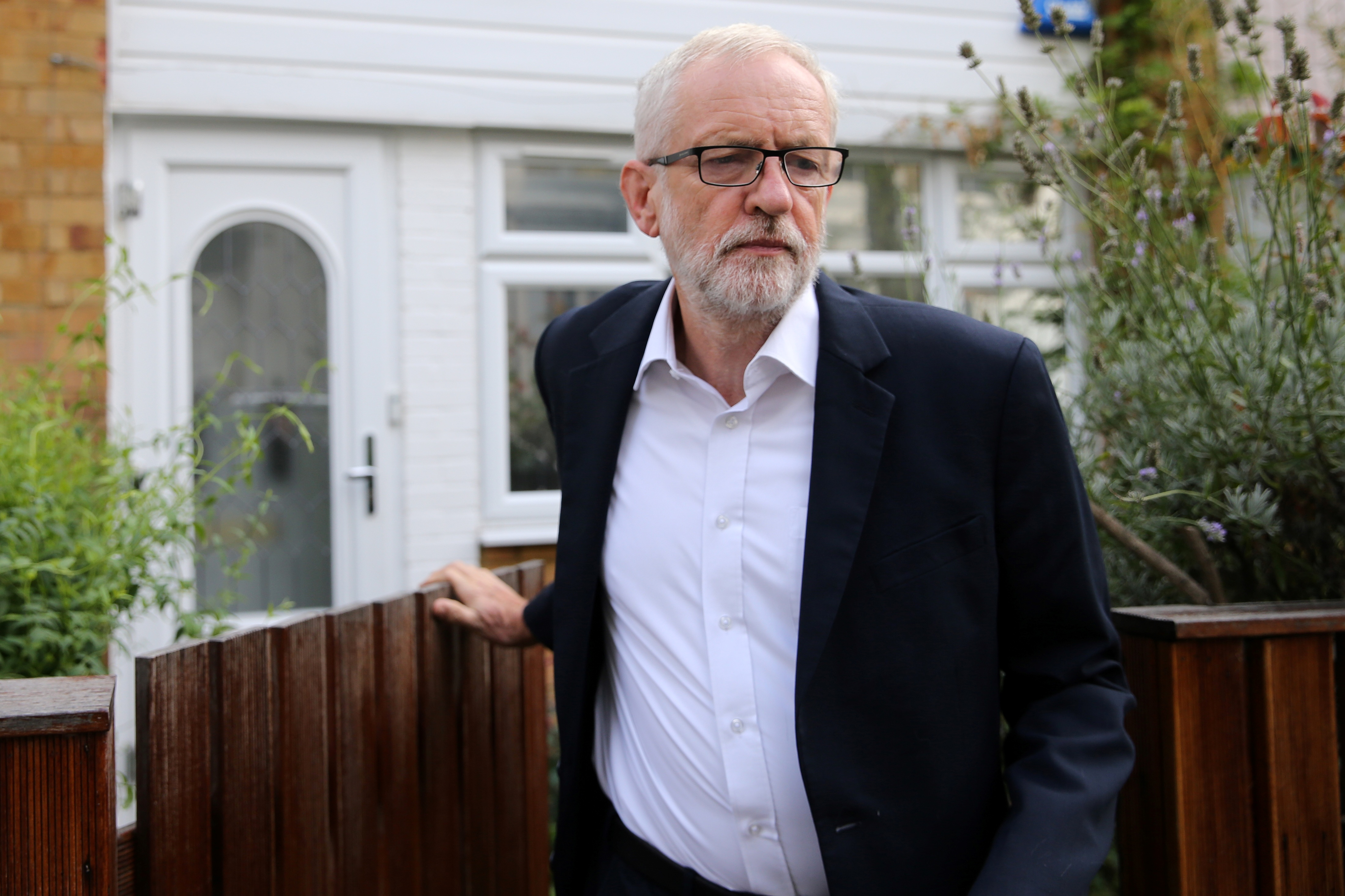 Britain's opposition Labour party leader Jeremy Corbyn leaves his home in north London Tuesday.