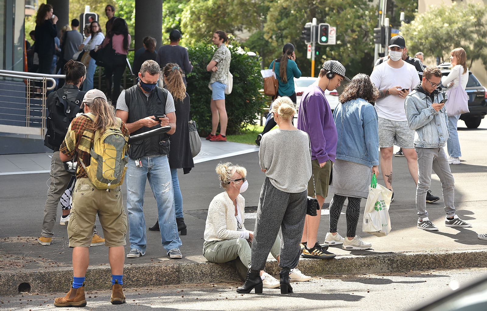 People queue outside a benefits payment center in Sydney on March 23.