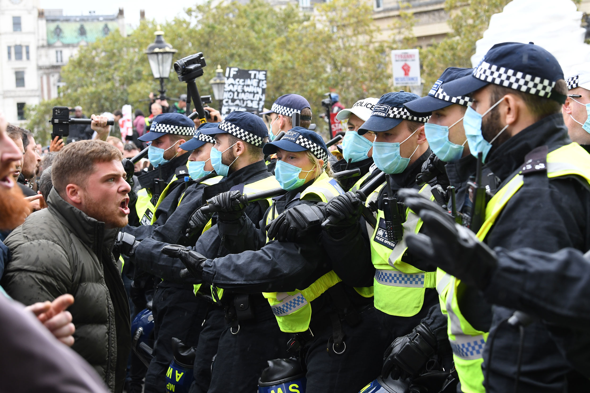 Police interact with demonstrators at an anti-lockdown protest at Trafalgar Square on September 26 in London.