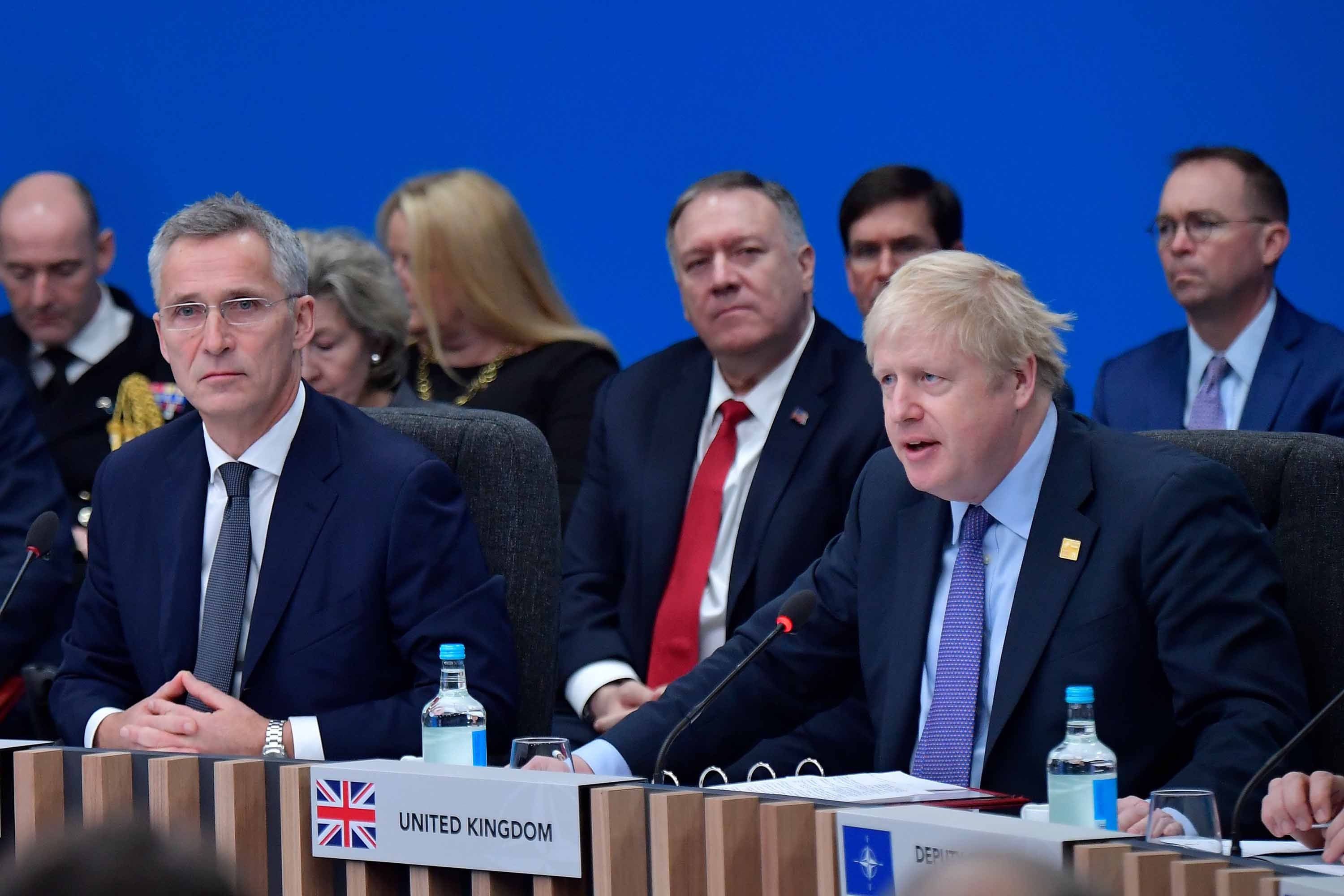 Prime Minister Johnson speaks at the plenary session of the NATO summit on Wednesday. Photo: Tobias Schwarz/AFP via Getty Images