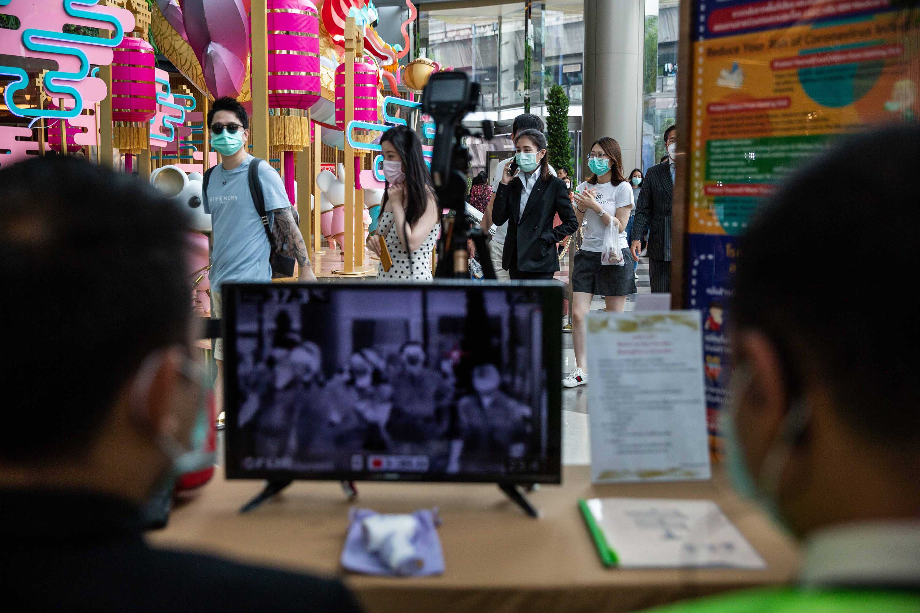 Thai officials conduct temperature screenings at a mall in Bangkok, Thailand on Tuesday.