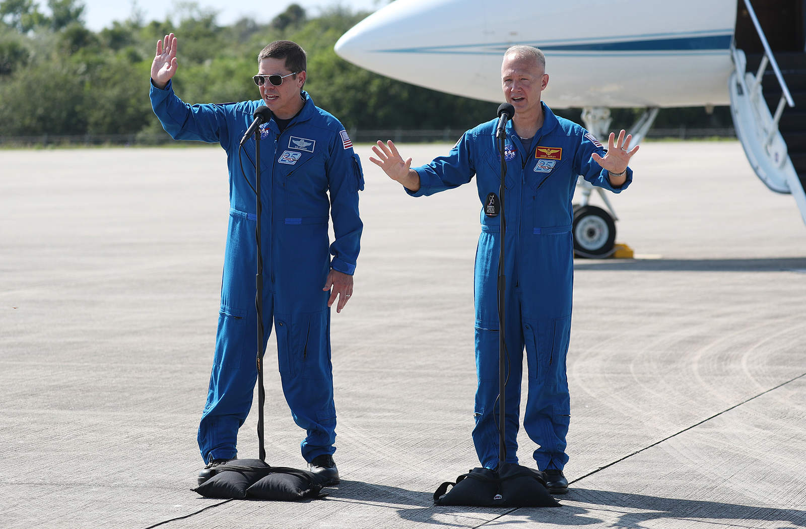 NASA astronauts Bob Behnken, left, and Doug Hurley speak to the media after arriving at the Kennedy Space Center on May 20, in Cape Canaveral, Florida.
