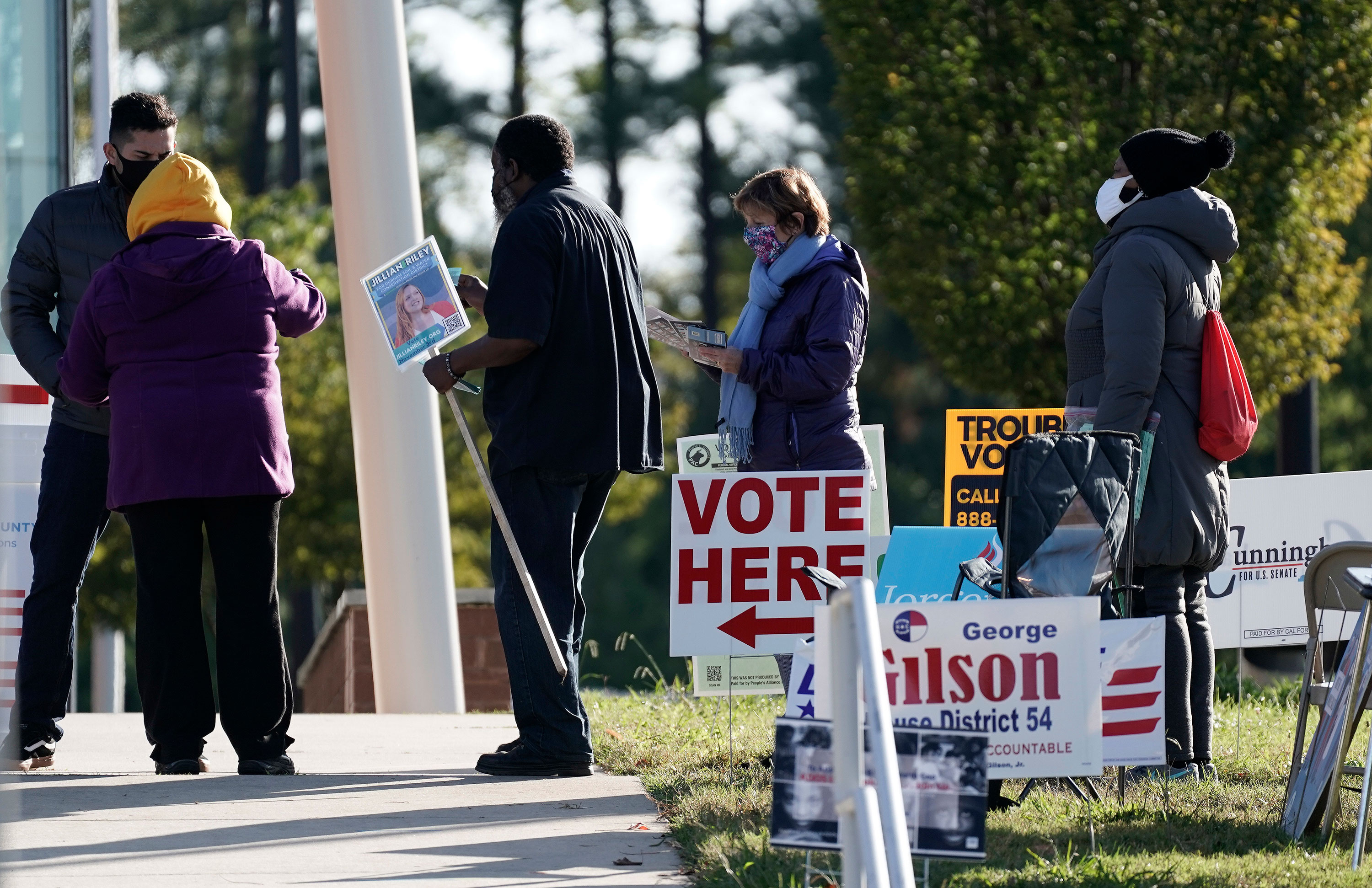 Voters wait in line at a polling location in Durham, North Carolina on Tuesday, November 3.