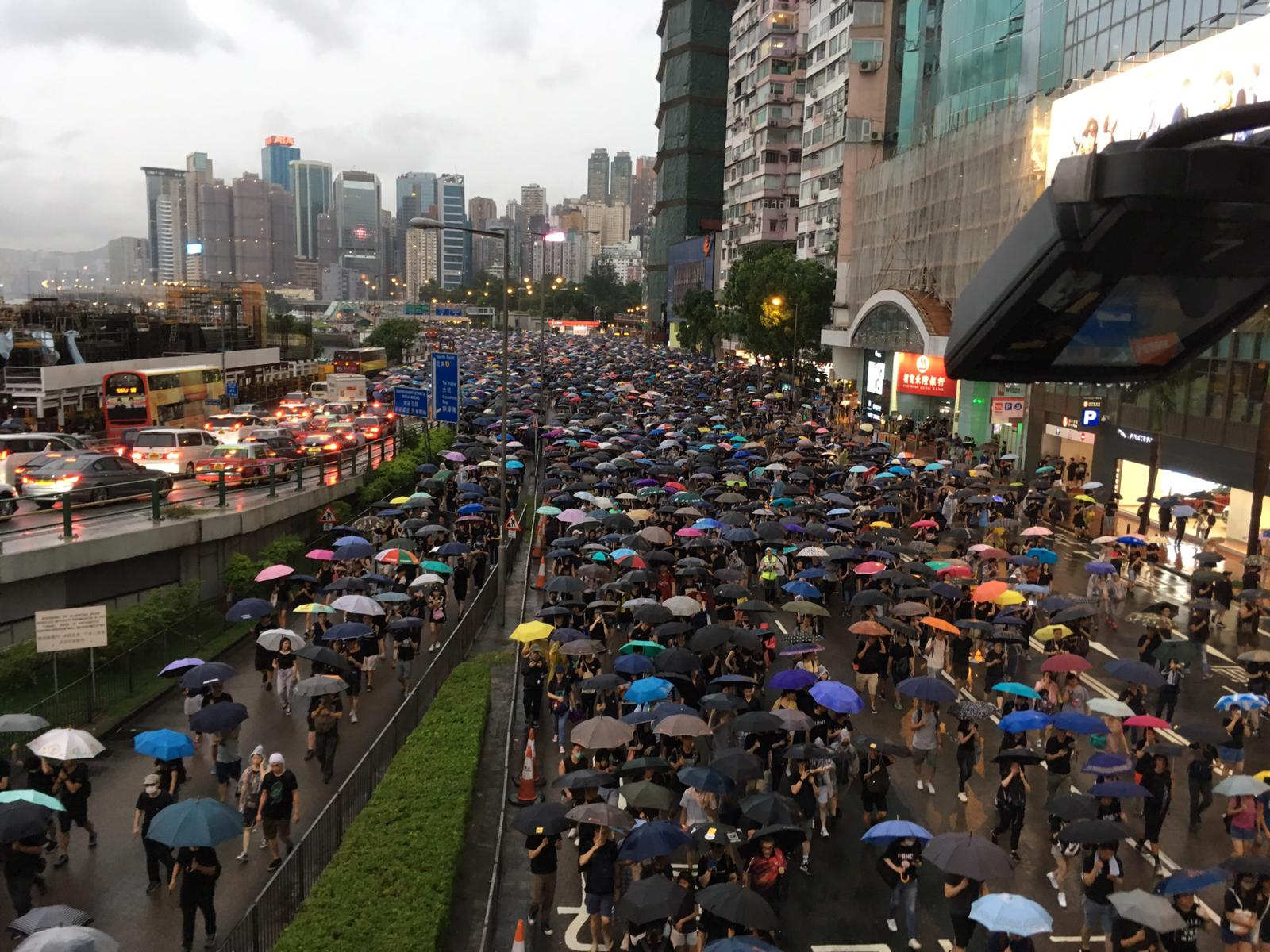 Protesters march westwards on Gloucester Road in Hong Kong.