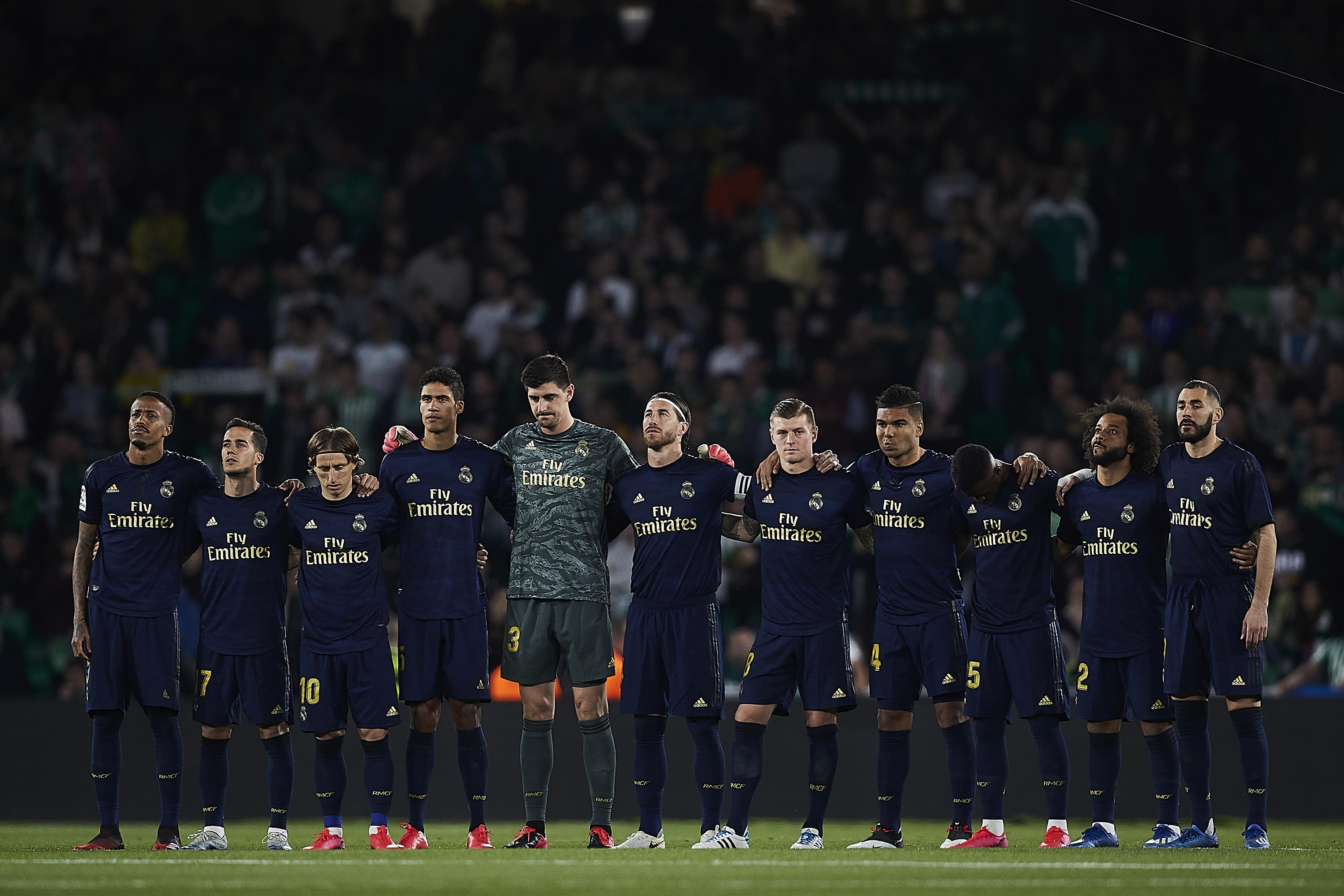Players of Real Madrid stand on the pitch prior to a Liga match with Real Betis, in Seville, Spain, on March 8.