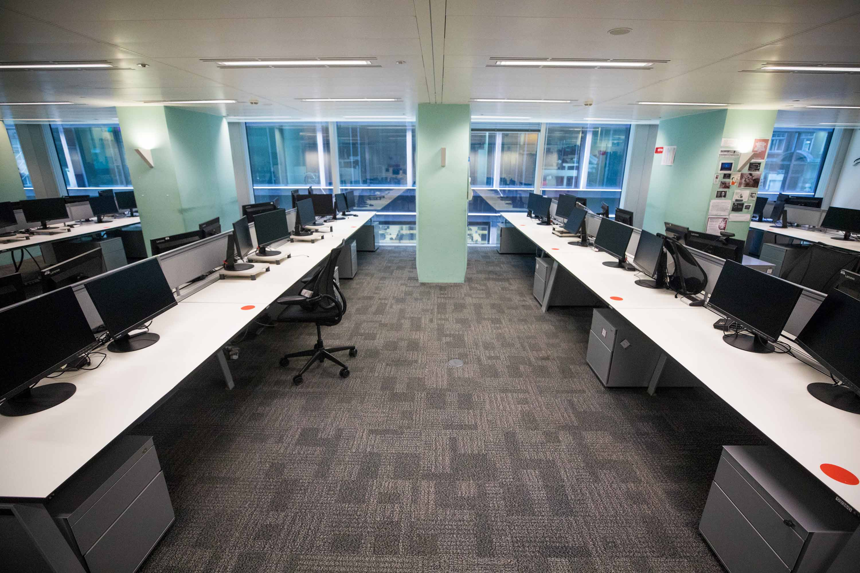 Empty desks are pictured at Cushman & Wakefield Plc's offices during the first phase of the reoccupation of their headquarters in London, on June 24.