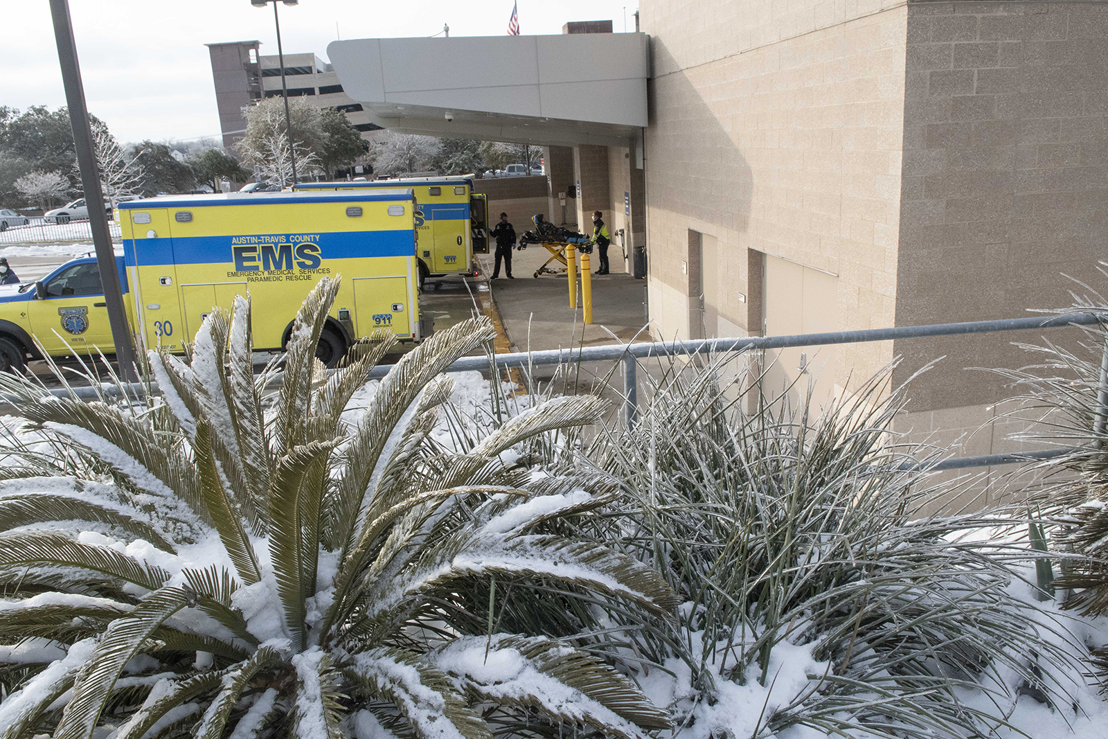 Emergency Medical Services workers load ambulances at Saint David's Medical Center in south Austin, Texas, after the hospital suffered water problems along with large swaths of the Austin metro area on February 18.