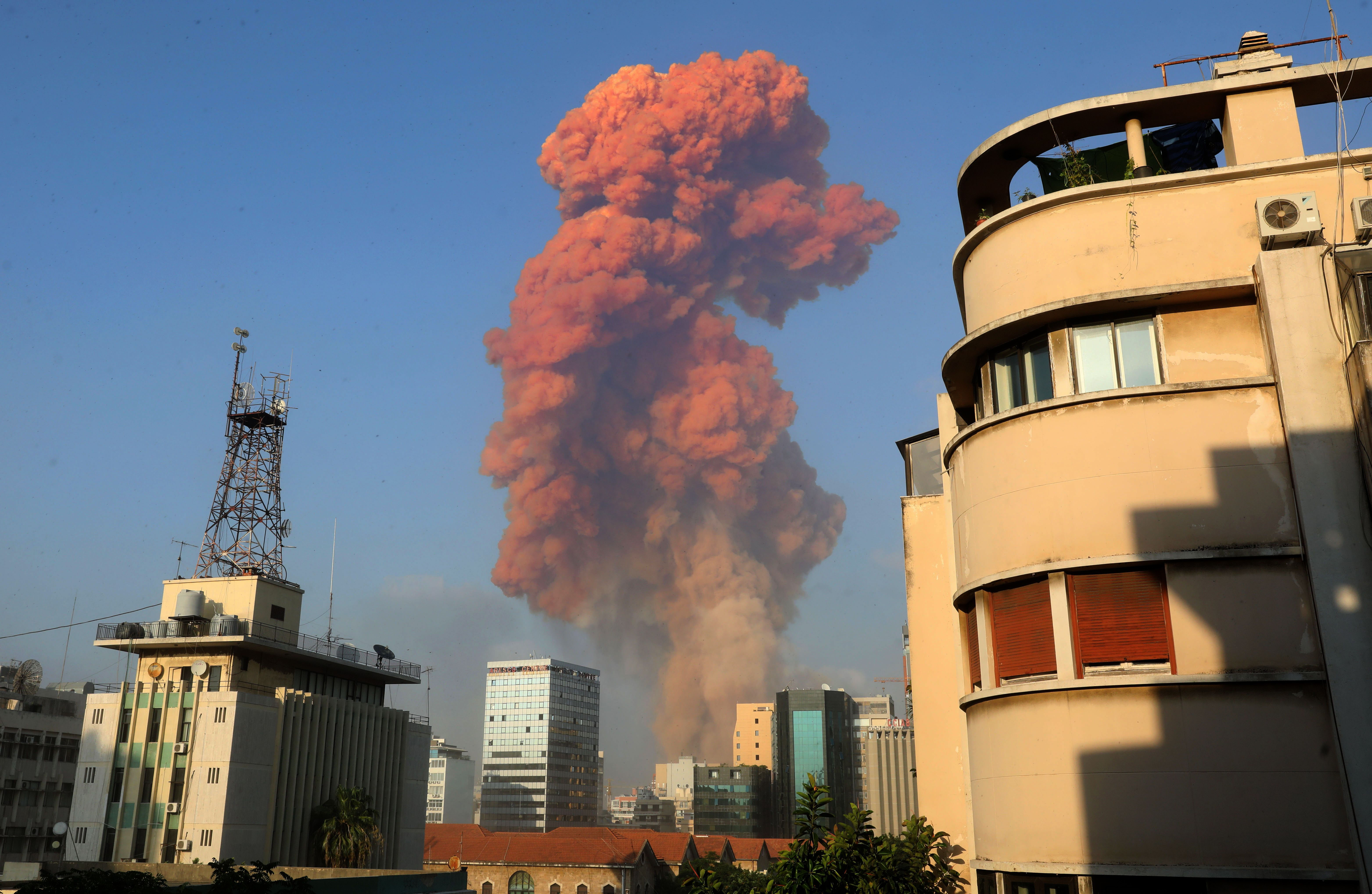 Red smoke rises after an explosion in Beirut, Lebanon, on August 4.
