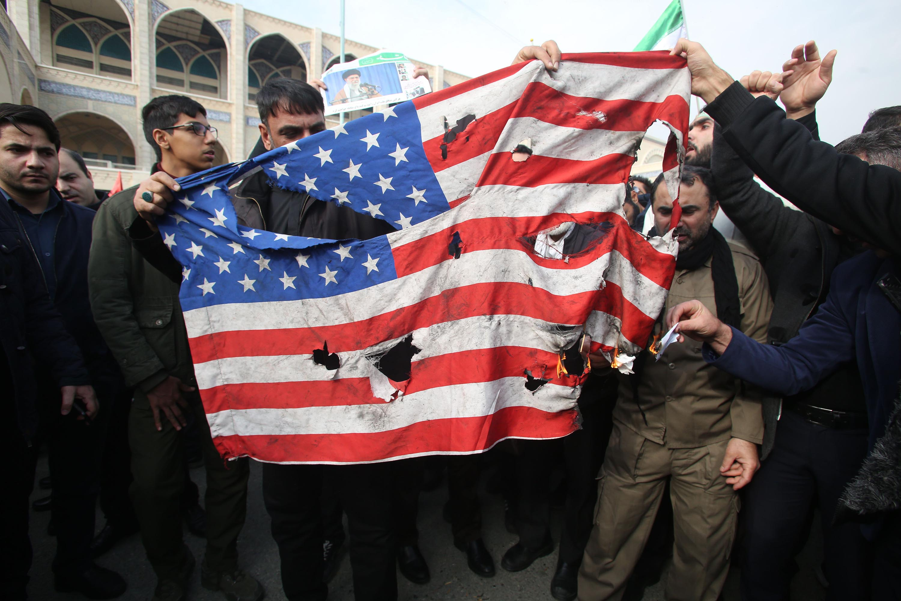Iranians burn a US flag during Friday's demonstration in Tehran. Credit: Atta Kenare/AFP via Getty Images