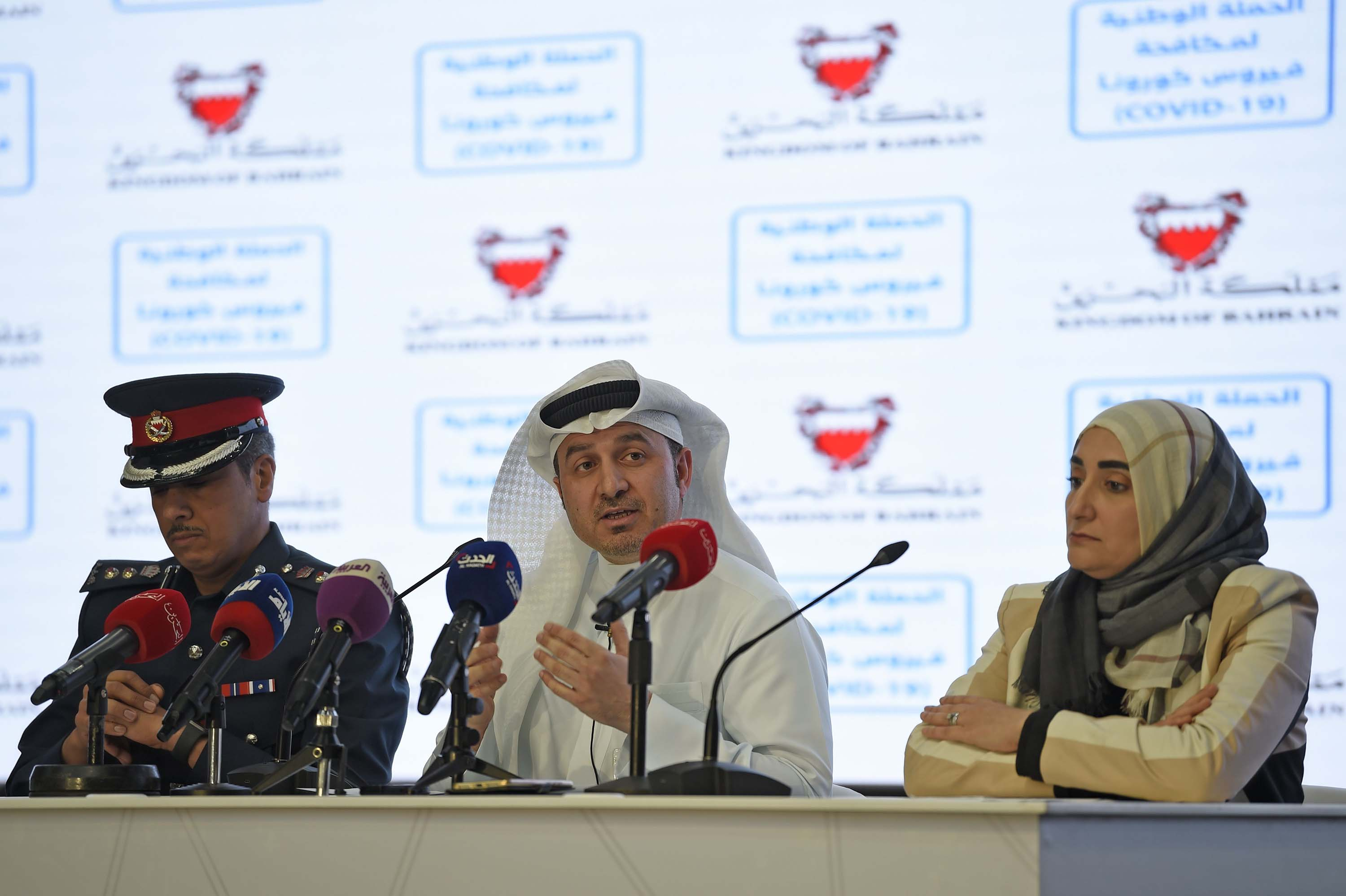 From left: Lieutenant Colonel Mohammed al-Benghdair, chief executive of the National Disaster Commission, and COVID-19 Task Force members Manaf al-Qahtani, alongside Jameela al-Salman, hold a press conference in the Bahraini city of Riffa on February 28.