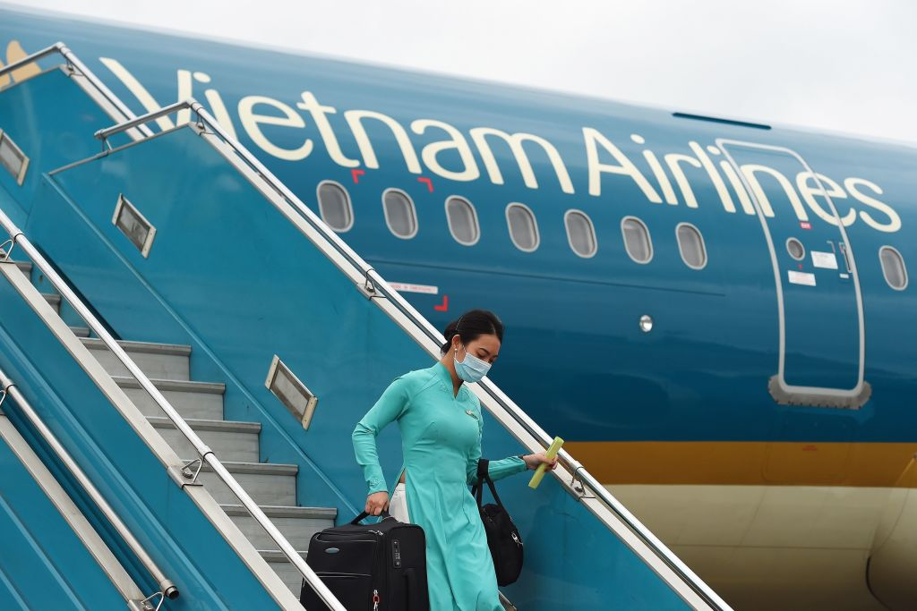 A Vietnam Airlines flight crew member disembarks from a flight returning from Taiwan at Noi Bai International Airport in Hanoi on March 3.