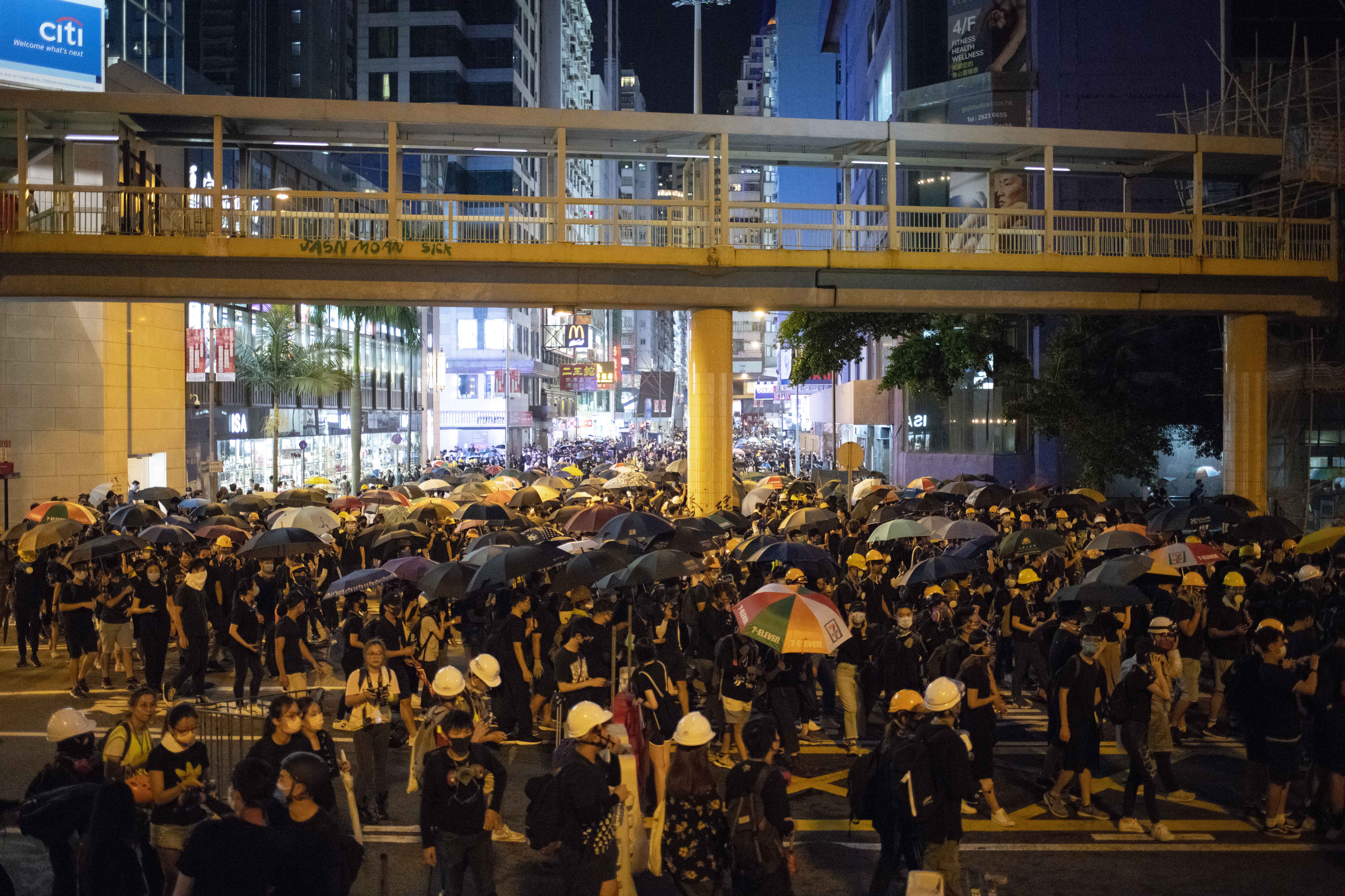 Protesters occupy Causeway Bay, one of Hong Kong's most crowded districts, on Sunday.