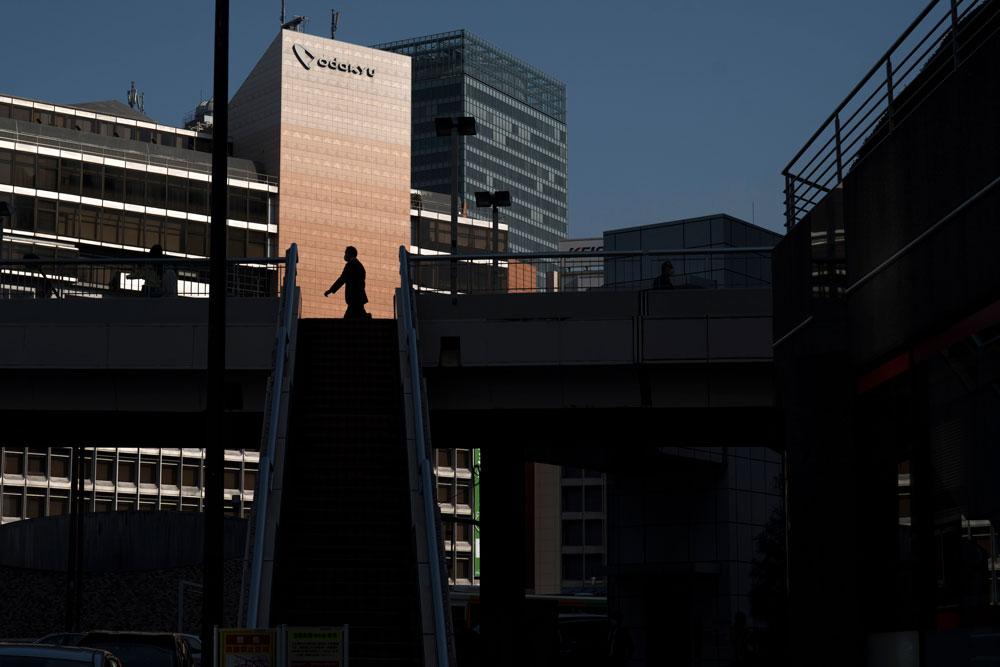 A man walks toward Shinjuku station, the world's busiest railway station, on April 8, 2020 in Tokyo, Japan.
