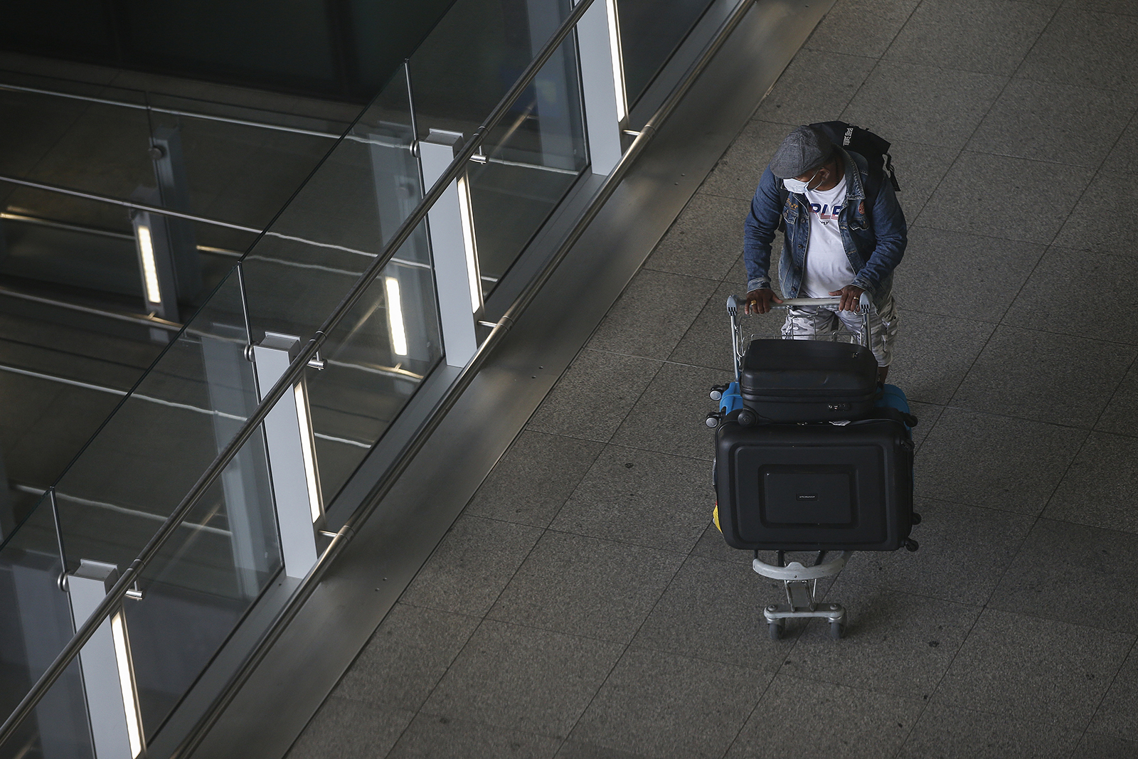 Travellers exit Heathrow Airport Terminal 2 on August 22, 2020 in London, England.