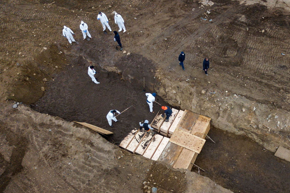 Drone pictures show bodies being buried on New York's Hart Island where the department of corrections is dealing with more burials overall, amid the coronavirus disease outbreak in New York City, on April 9.