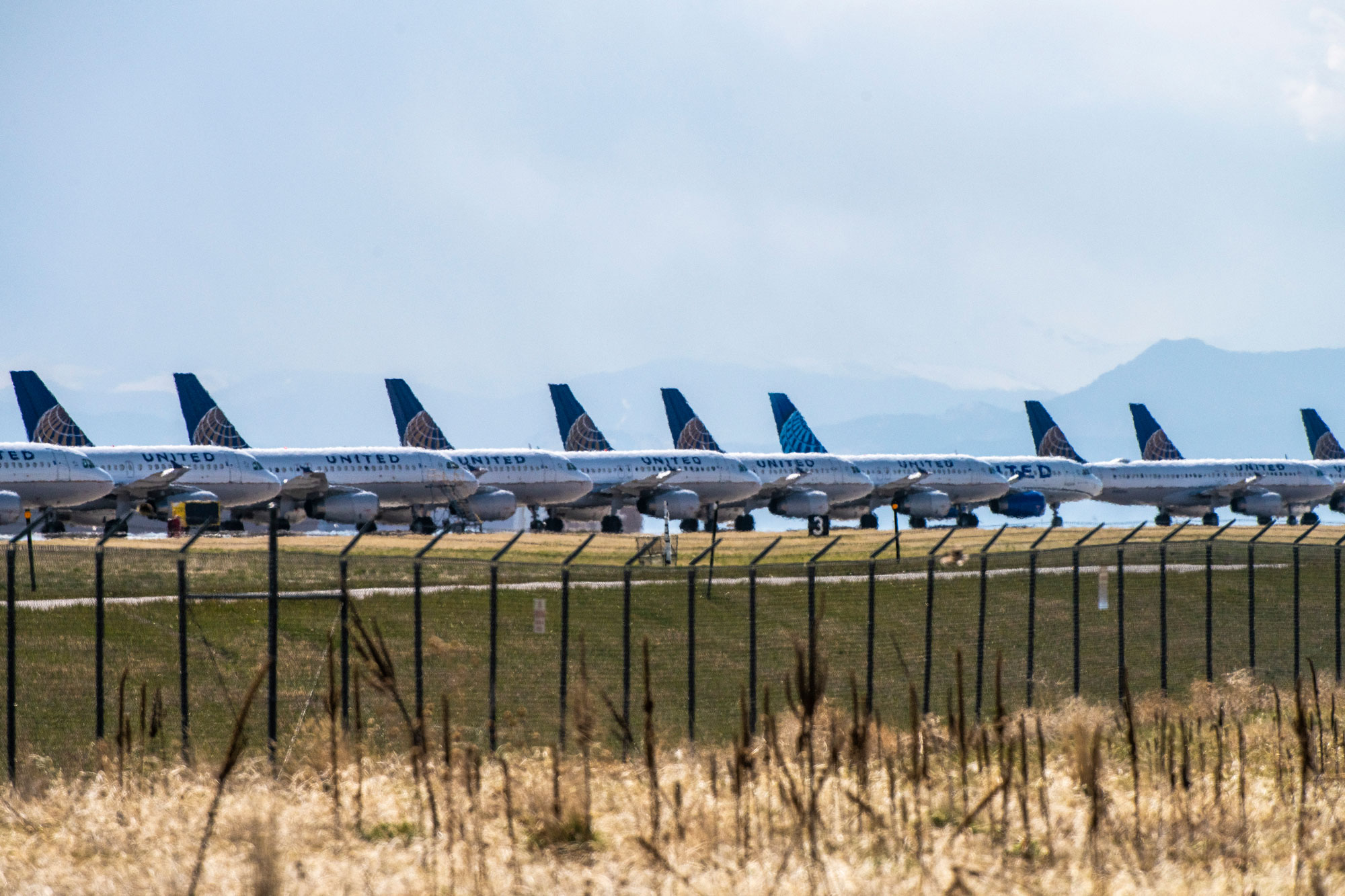 United Airlines planes sit parked on a runway at Denver International Airport as the coronavirus pandemic slows air travel on April 22, in Denver.