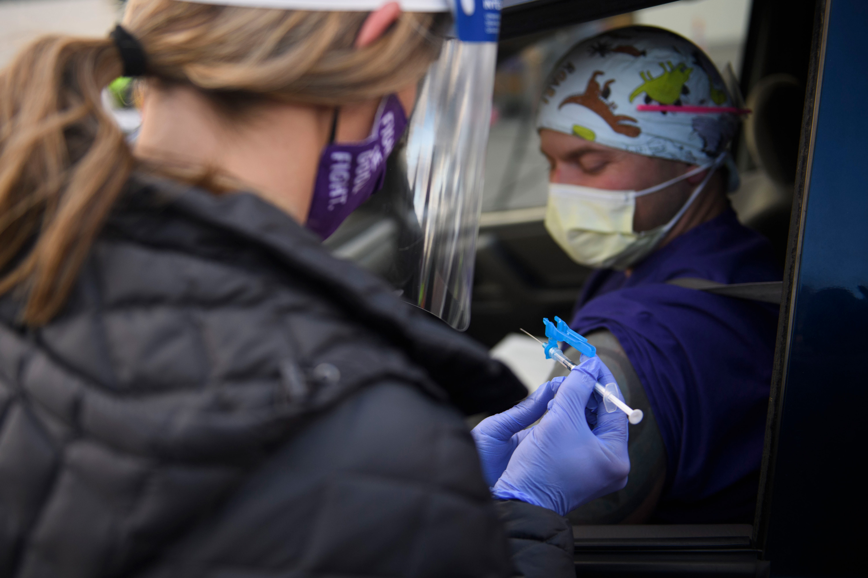 A nurse prepares to administer a first dose of the Pfizer-BioNTech Covid-19 vaccine to a front-line health care worker at a drive up vaccination site in Reno, Nevada on December 17.