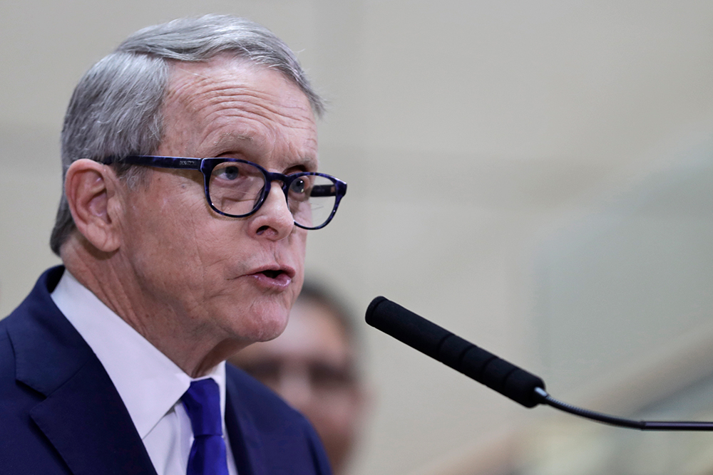 In this file photo, Ohio Governor Mike DeWine speaks at a press conference about the state's preparedness to limit the spread of the coronavirus on Thursday, February 27 in Cleveland.