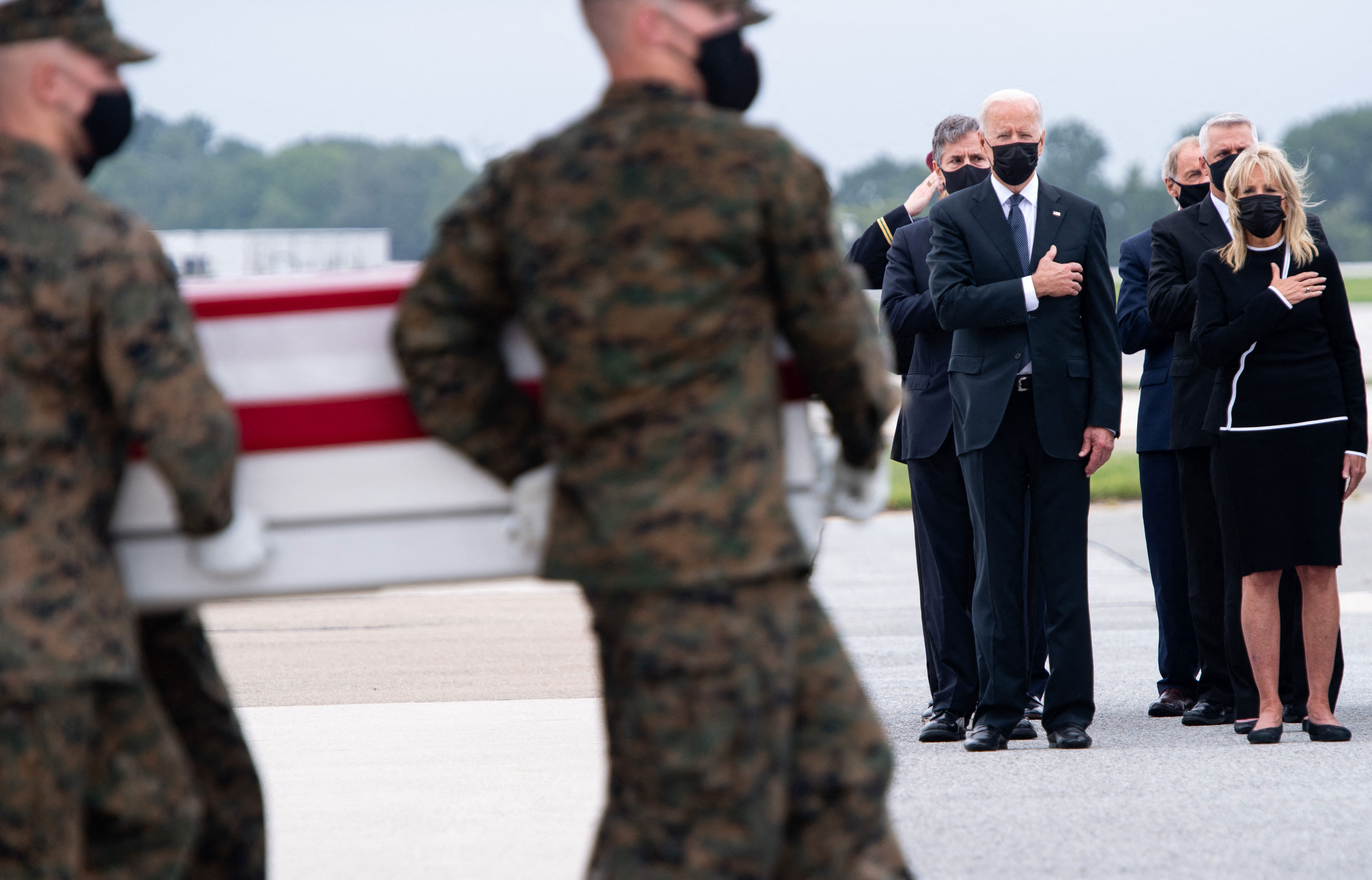 US President Joe Biden and first lady Jill Biden attend the dignified transfer of 13 service members at Dover Air Force Base in Dover, Delaware, on August 29, 2021. The service members were killed in Kabul, Afghanistan, on August 26, 2021.