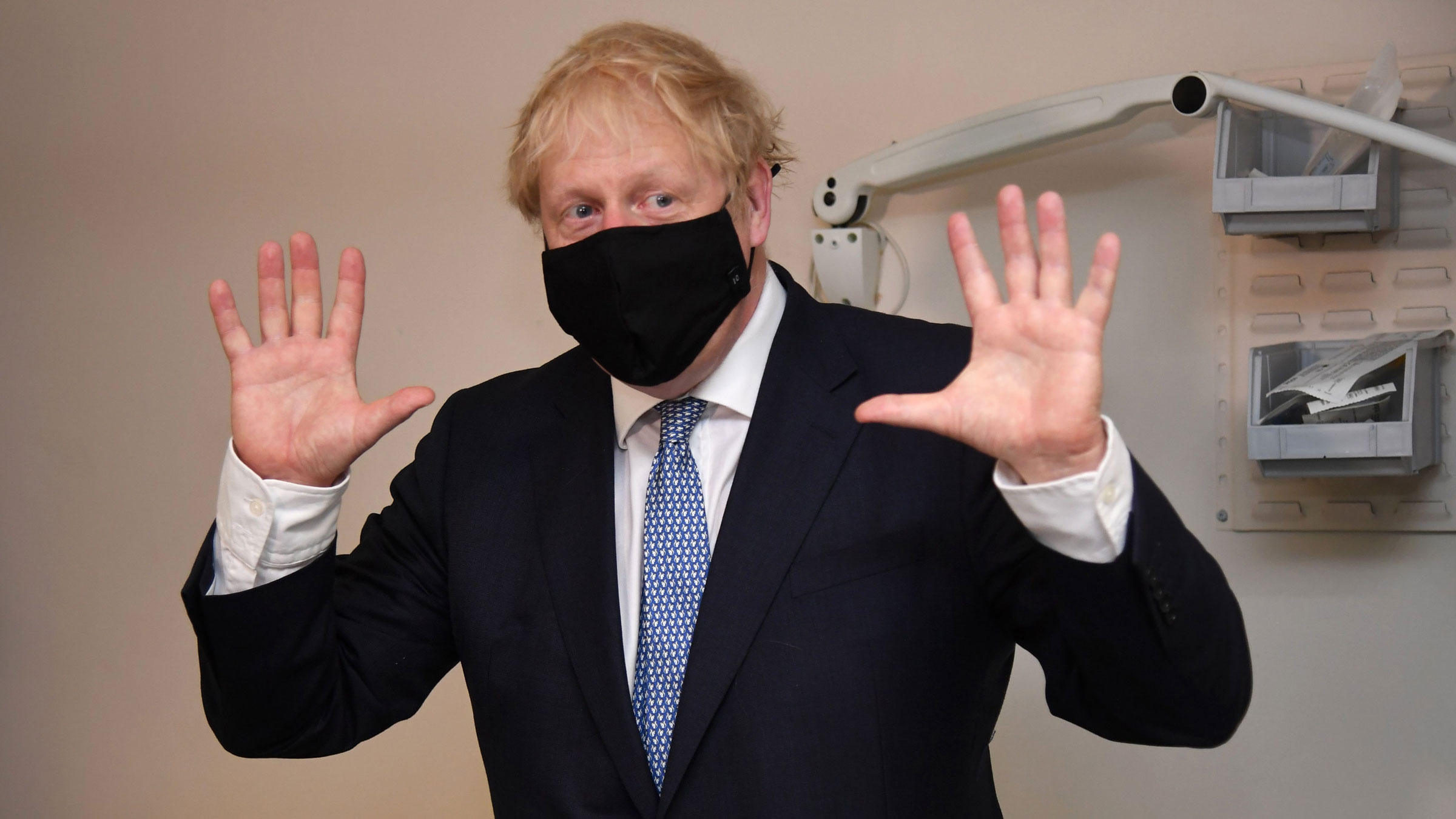 British Prime Minister Boris Johnson gestures during a visit to the Tollgate Medical Centre in London on Friday.