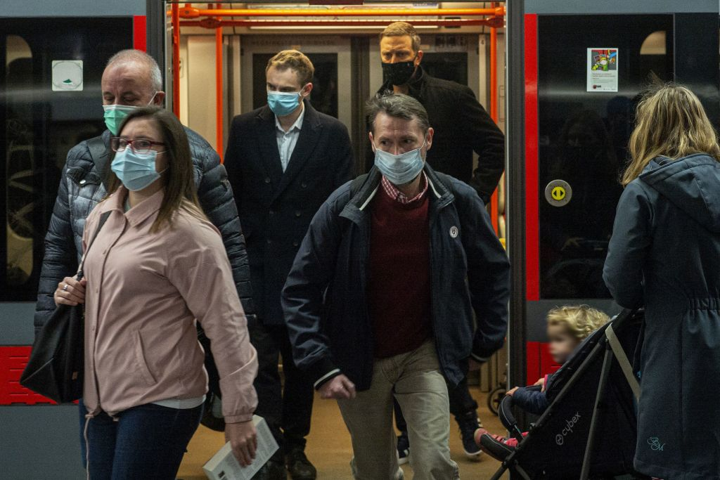 Commuters in Prague wear masks in a metro station on Tuesday, after new restrictions in the Czech Republic came into force.