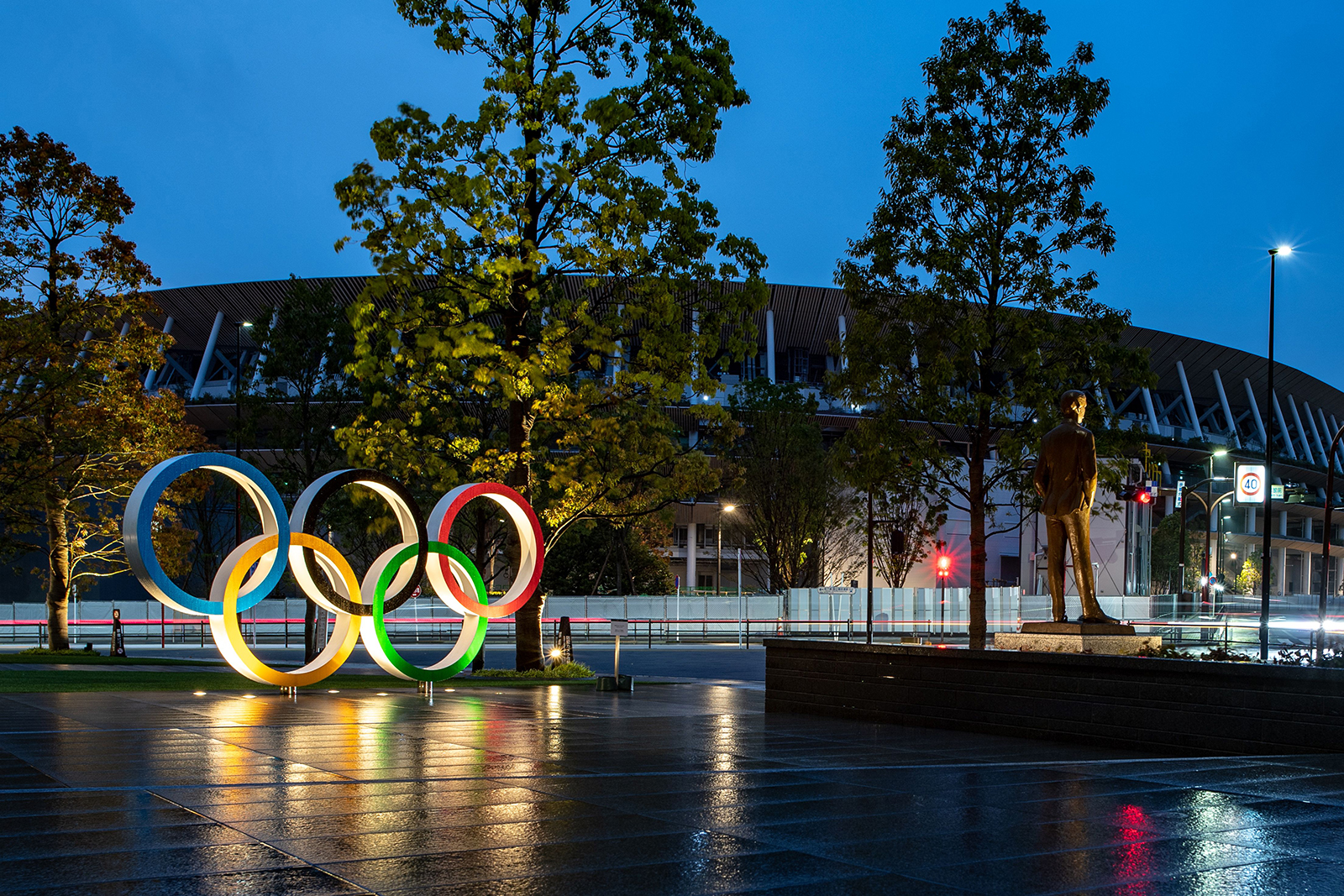The Olympic Rings are displayed before the National Stadium in Tokyo on April 20.