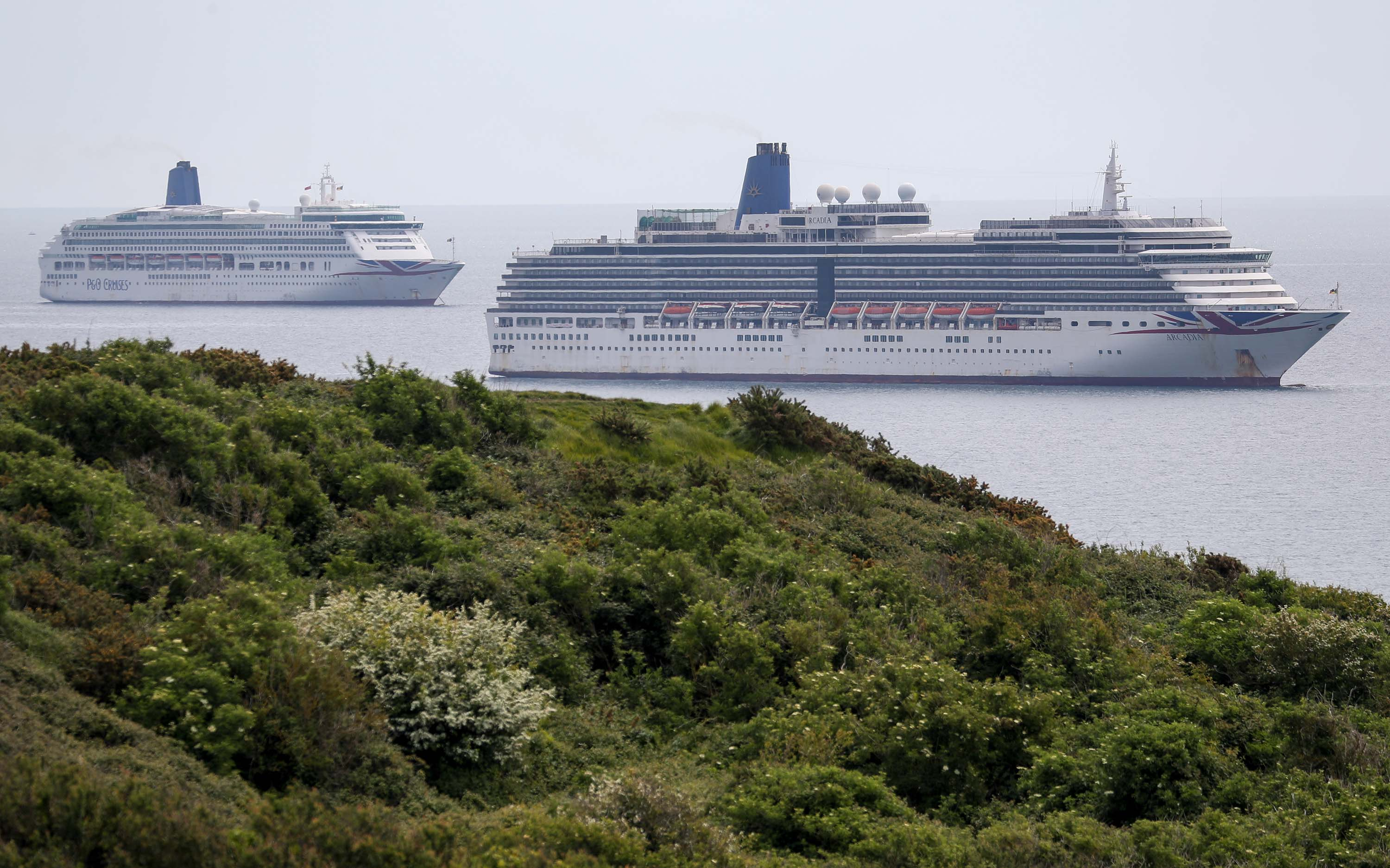 P&O cruise ships Aurora, left, and Arcadia are pictured at berth in Weymouth Bay, England, on May 17.