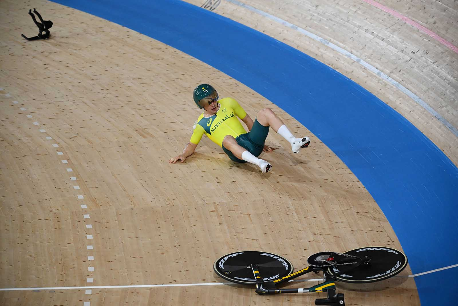 Australia's Alexander Porter reacts after crashing during the men's track cycling team pursuit qualifying event in Izu, Japan, on Monday.