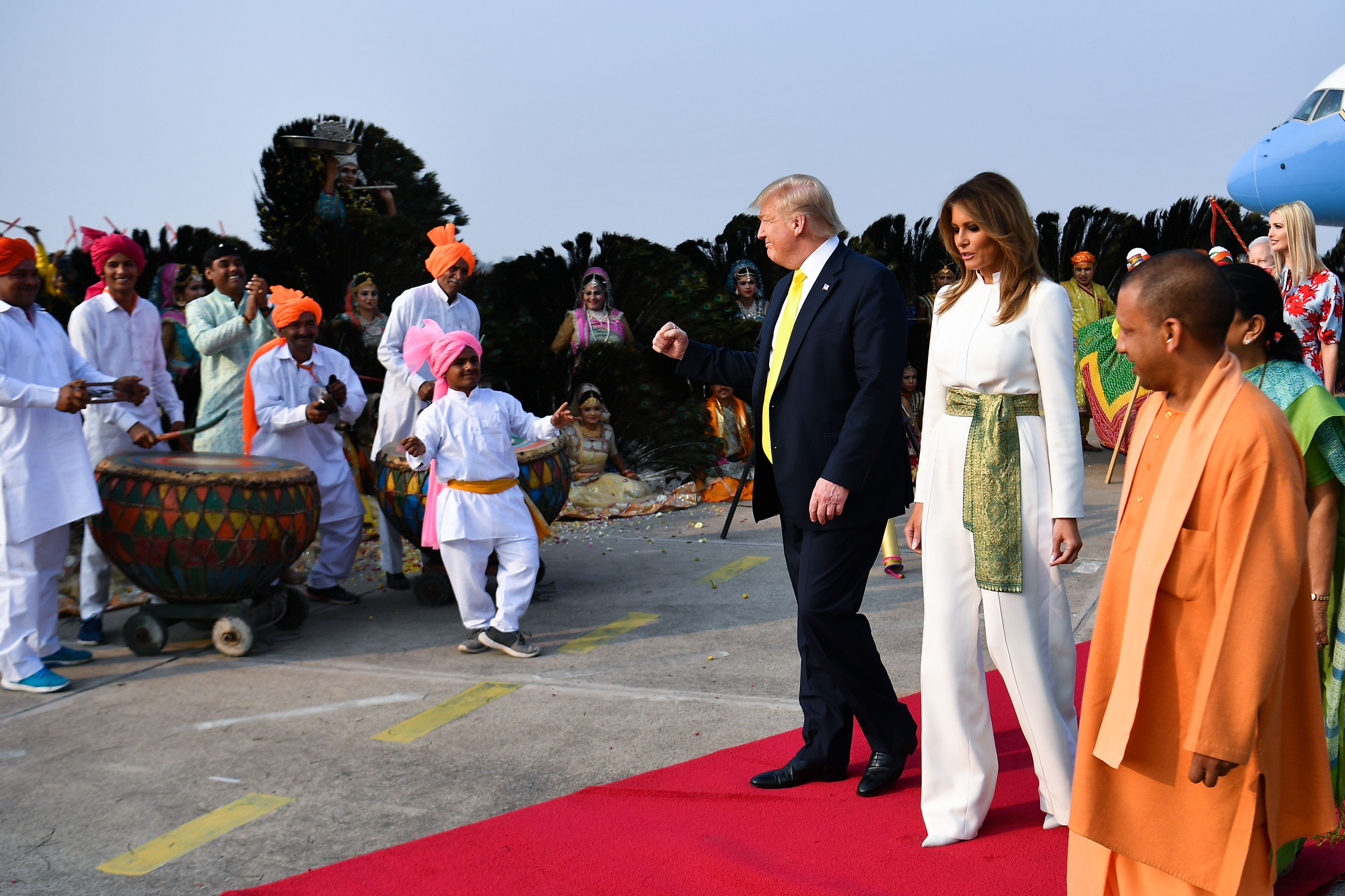 Performers wearing traditional costumes greet President and first lady Trump in Agra.