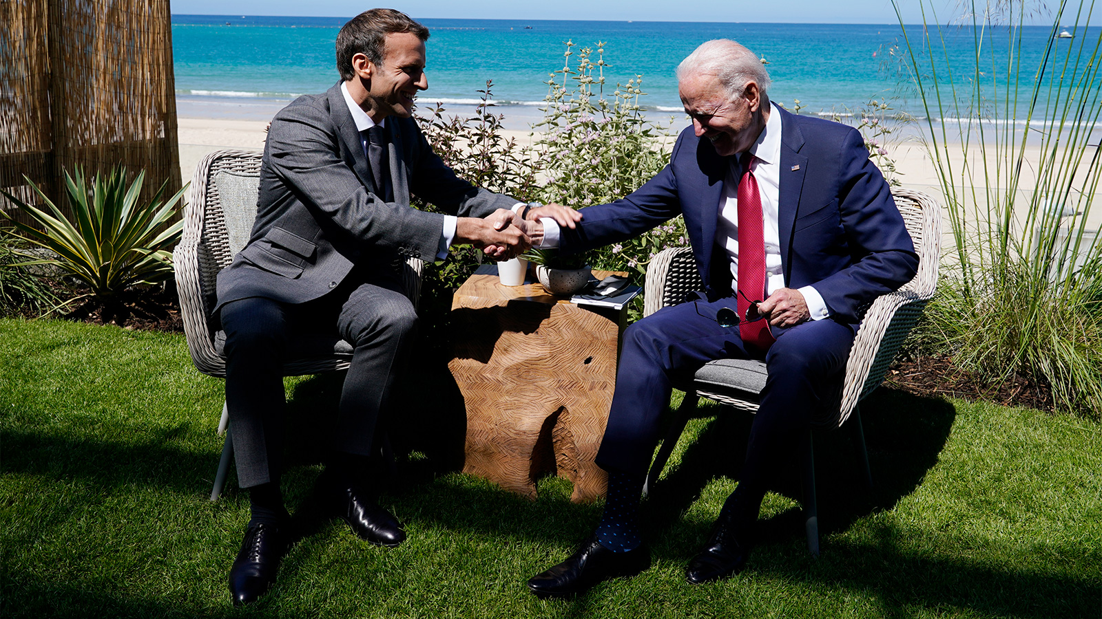 President Joe Biden and French President Emmanuel Macron visit during a bilateral meeting at the G7 summit on Saturday in Carbis Bay, England.