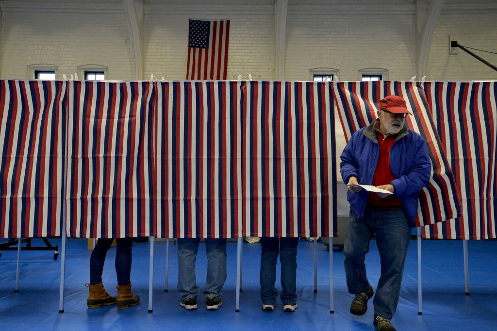 Voters cast their ballots at the Ward Five Community Center during the New Hampshire primary in Concord on Feb. 11, 2020.
