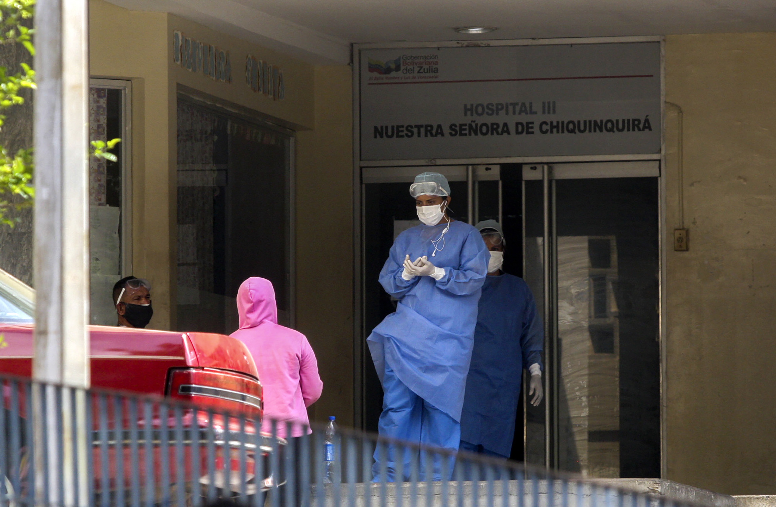 Medical personnel are seen outside the emergency room of the University Hospital in Maracaibo, in Venezuela, on July 2, amid the Covid-19 pandemic.