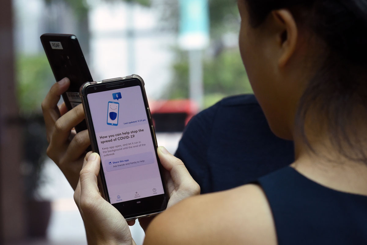 Government Technology Agency staff demonstrate Singapore's new contact-tracing smartphone app called TraceTogether, which was launched as a preventive measure against the novel coronavirus on March 20, 2020.