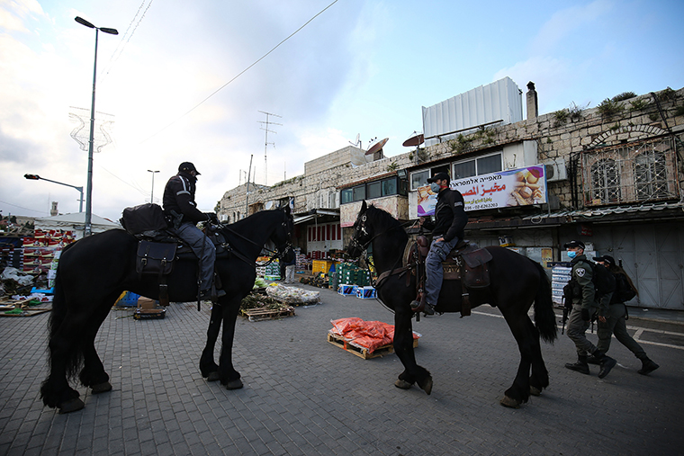 Mounted Israeli security forces patrol at a market due to restrictions imposed as measures against the novel coronavirus in Jerusalem on April 25.