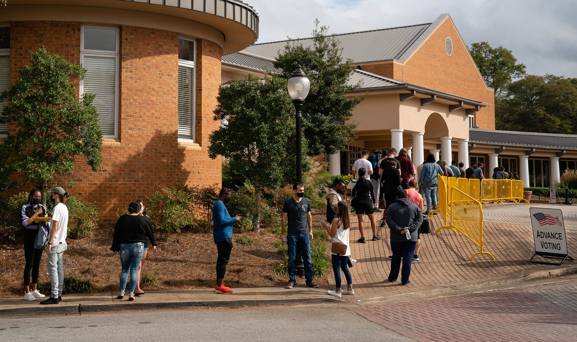 People wait in line to cast their ballots at an early voting location in the Smyrna Community Center on October 24 in Smyrna, Georgia.